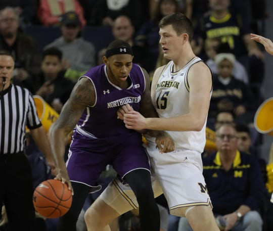 Jon Teske defends Dererk Pardon during the first half Sunday.
