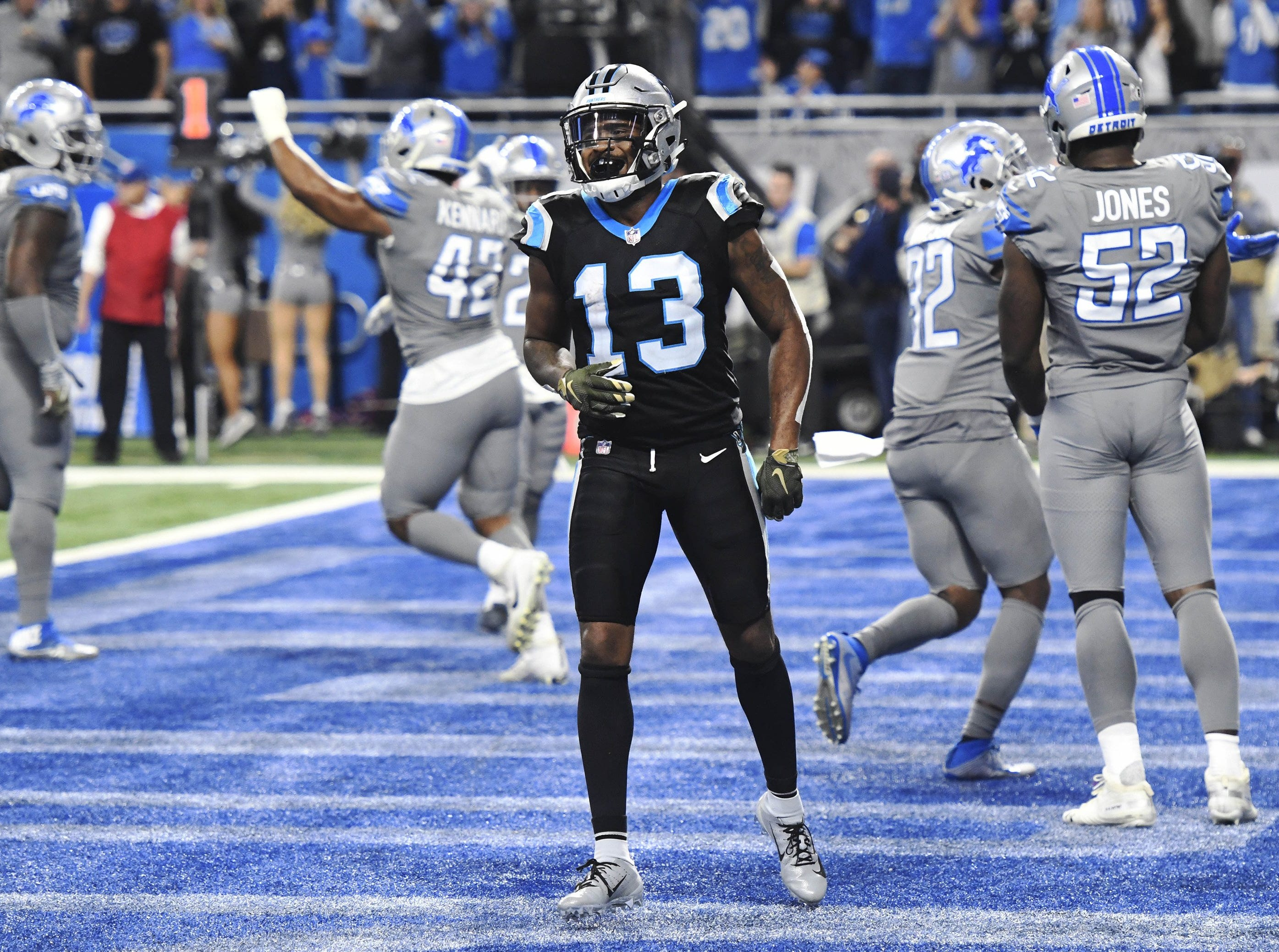 Lions defenders celebrate after breaking up a two-point conversion pass intended for Panthers wide receiver Jarius Wright late in the Lions' 20-19 win on Sunday, Nov. 18, 2018, at Ford Field.