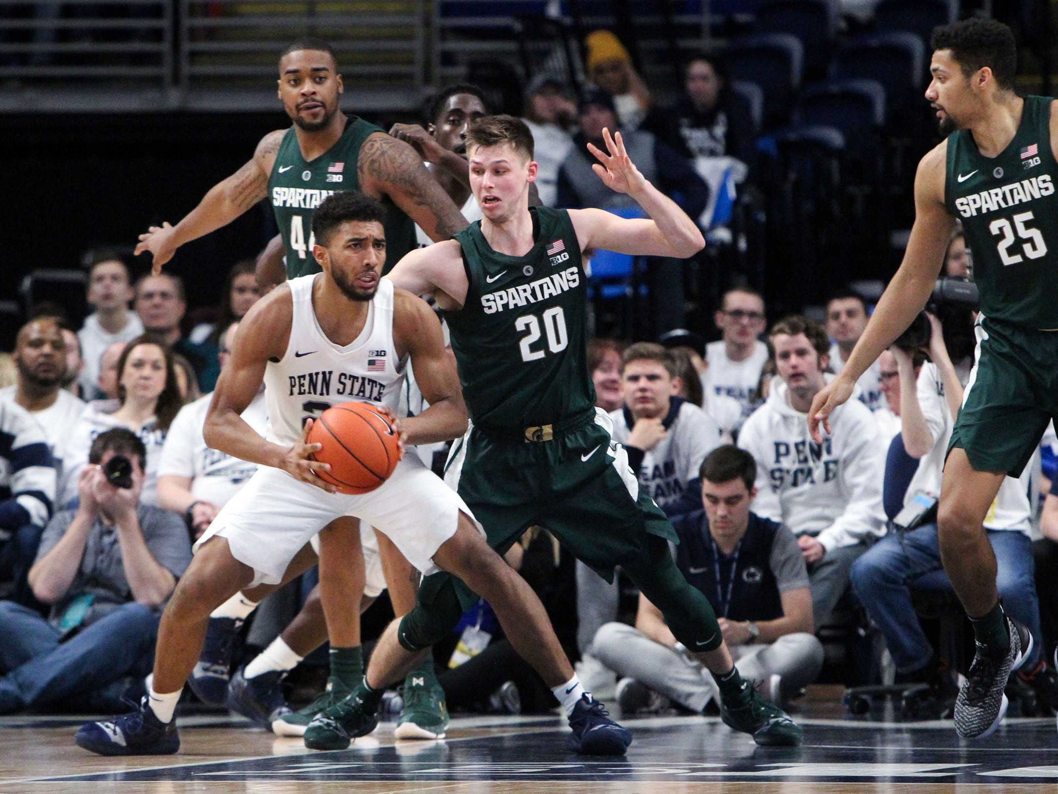 Penn State guard Josh Reaves dribbles against Michigan State guard Matt McQuaid during the second half in State College, Pa. Sunday, Jan. 13, 2019.
