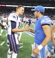 Lions quarterback Matthew Stafford and Patriots quarterback Tom Brady shake hands after an exhibition game Aug. 25, 2017 at Ford Field.