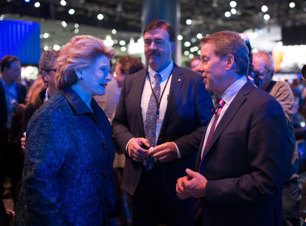 Ford Motor Co. Executive Chairman Bill Ford Jr. speaks with Senator Debbie Stabenow during the 2019 North American International Auto Show held at Cobo Center in downtown Detroit on Monday, Jan. 14, 2019.