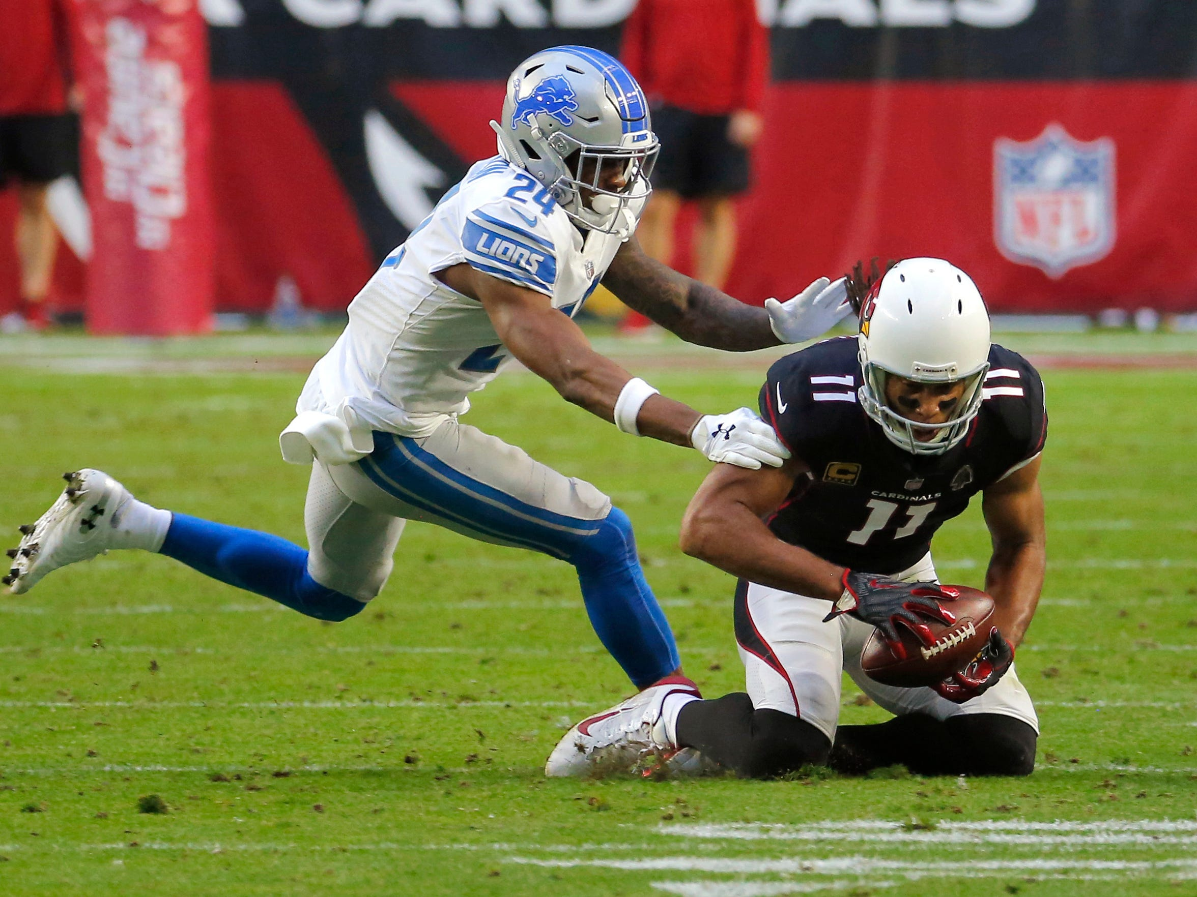 Cardinals wide receiver Larry Fitzgerald makes his 1,282nd career catch as Lions cornerback Nevin Lawson defends during the second half of the Lions' 17-3 win on Sunday, Dec. 9, 2018, in Glendale, Ariz.