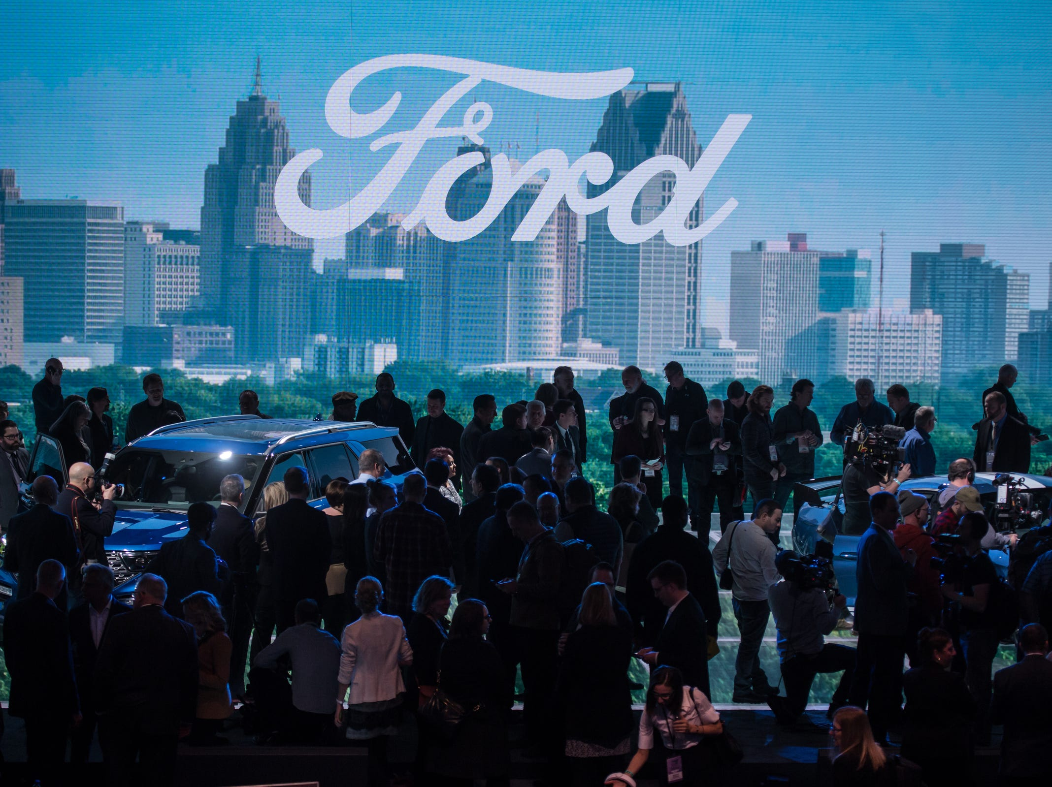 Media crowd around the vehicles revealed for Ford Motor Co. during the 2019 North American International Auto Show held at Cobo Center in downtown Detroit on Monday, Jan. 14, 2019.