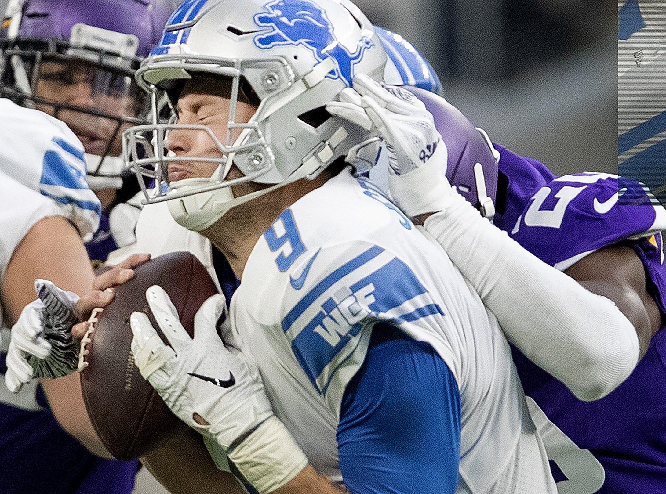 The Vikings' MacKensie Alexander sacks Lions quarterback Matthew Stafford in the third quarter of the Lions' 24-9 loss on Sunday, Nov. 4, 2018, in Minneapolis.