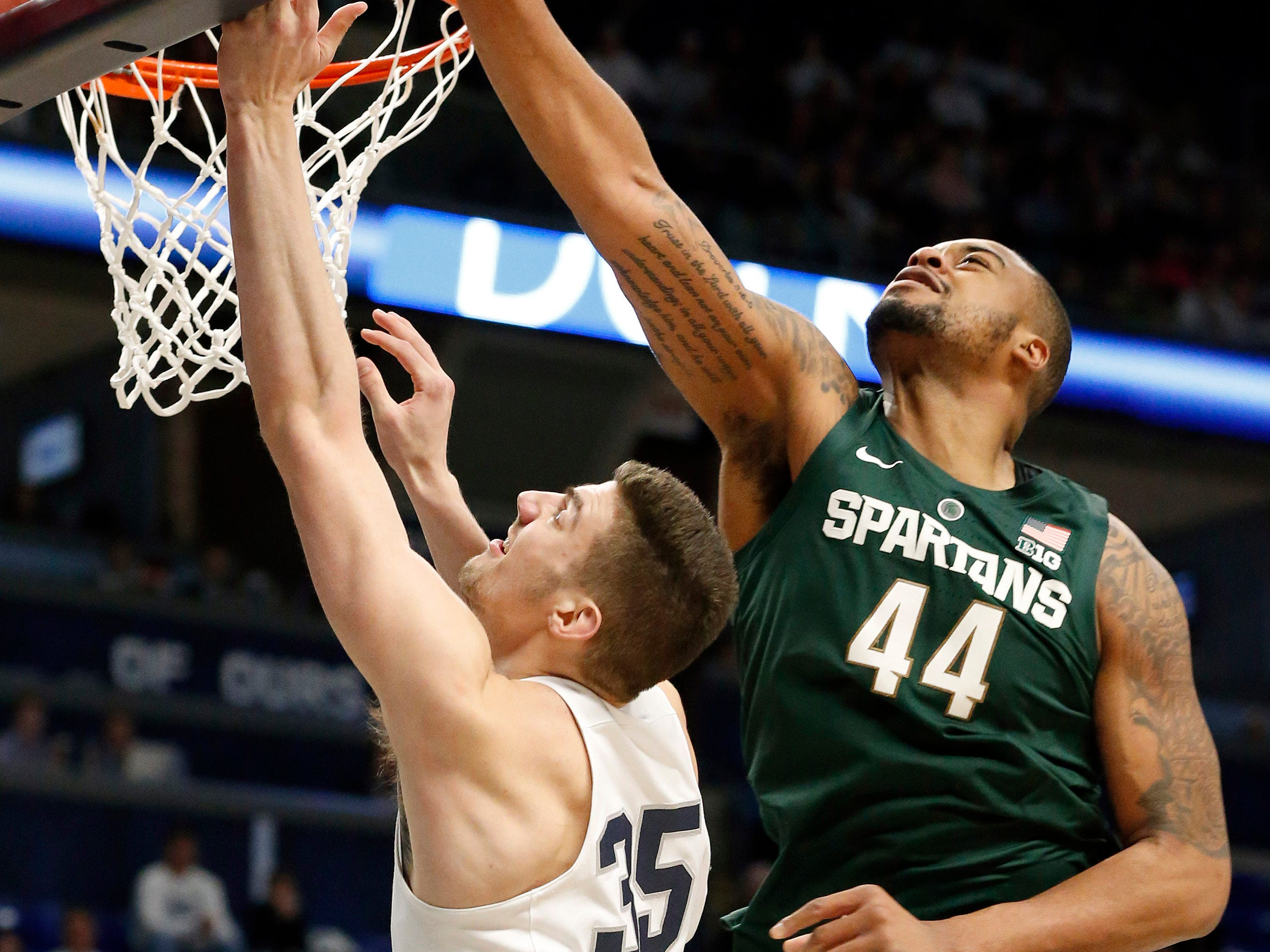 Michigan State's Nick Ward blocks a shot by Penn State's Trent Butrick during the second half in State College, Pa. Sunday, Jan. 13, 2019.
