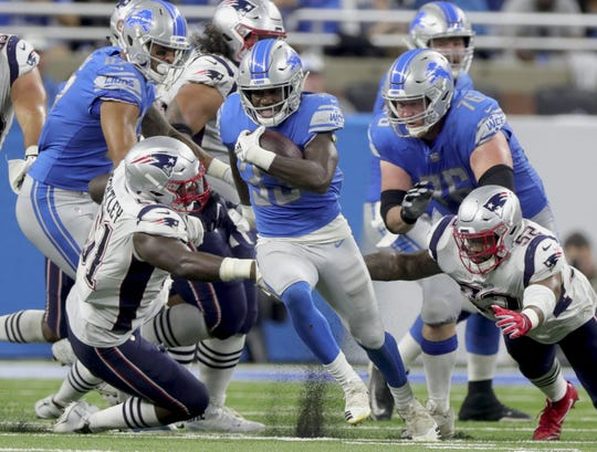 Lions running back Kerryon Johnson runs the ball against the Patriots during the second half of the Lions' 26-10 win on Sunday, Sept. 23, 2018, at Ford Field.