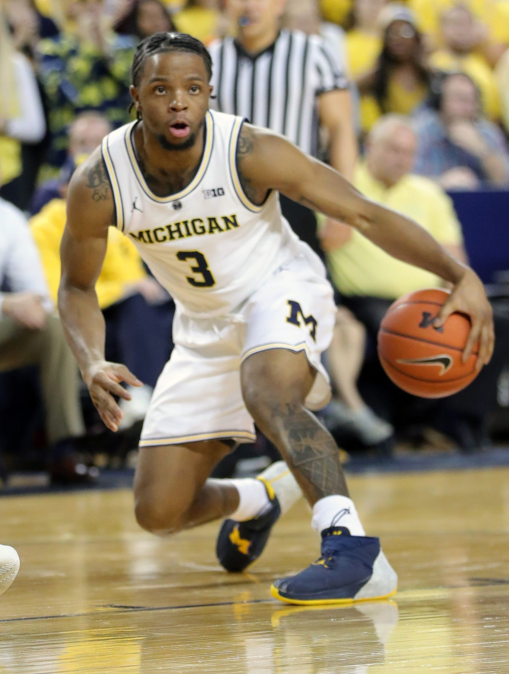 Michigan guard Zavier Simpson drives against Northwestern on Sunday, Jan. 13, 2019 at Crisler Center in Ann Arbor.