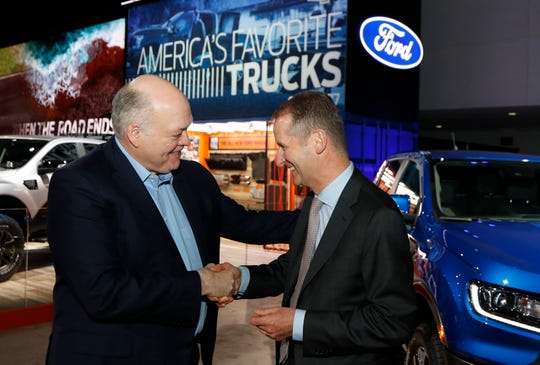 Ford Motor Co. President and CEO, Jim Hackett, left, meets with Dr. Herbert Diess, CEO of Volkswagen AG, Monday, Jan. 14, 2019, at the North American International Auto Show in Detroit.