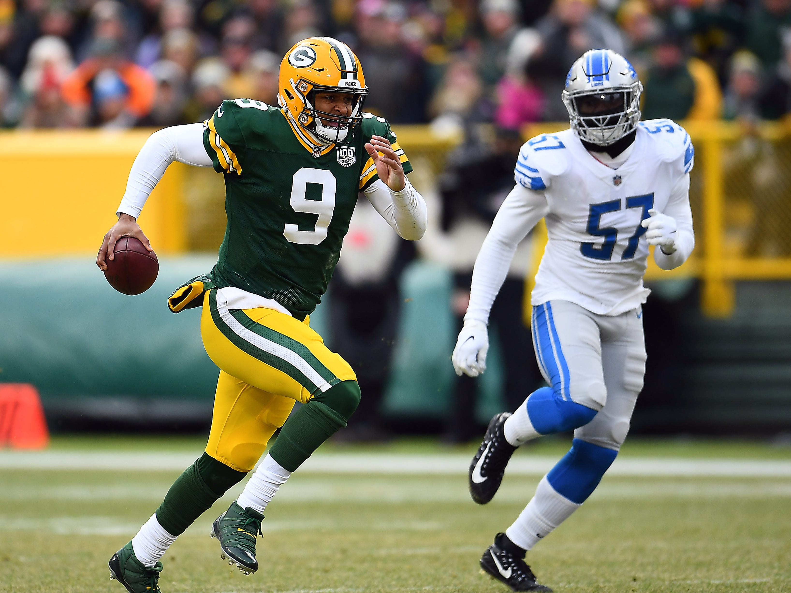 Packers quarterback DeShone Kizer runs in front of Lions linebacker Eli Harold during the second half of the Lions' 31-0 win on Sunday, Dec. 30, 2018, in Green Bay, Wis.