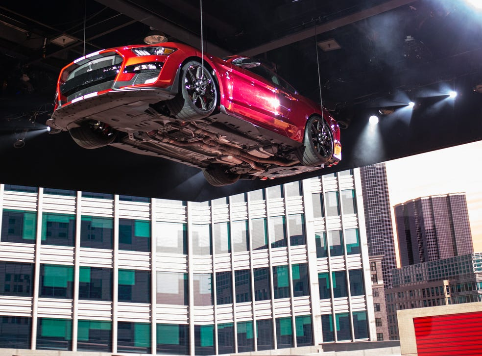 The all-new 2020 Mustang Shelby GT 500 is lowered from the ceiling during the 2019 North American International Auto Show held at Cobo Center in downtown Detroit on Monday, Jan. 14, 2019.