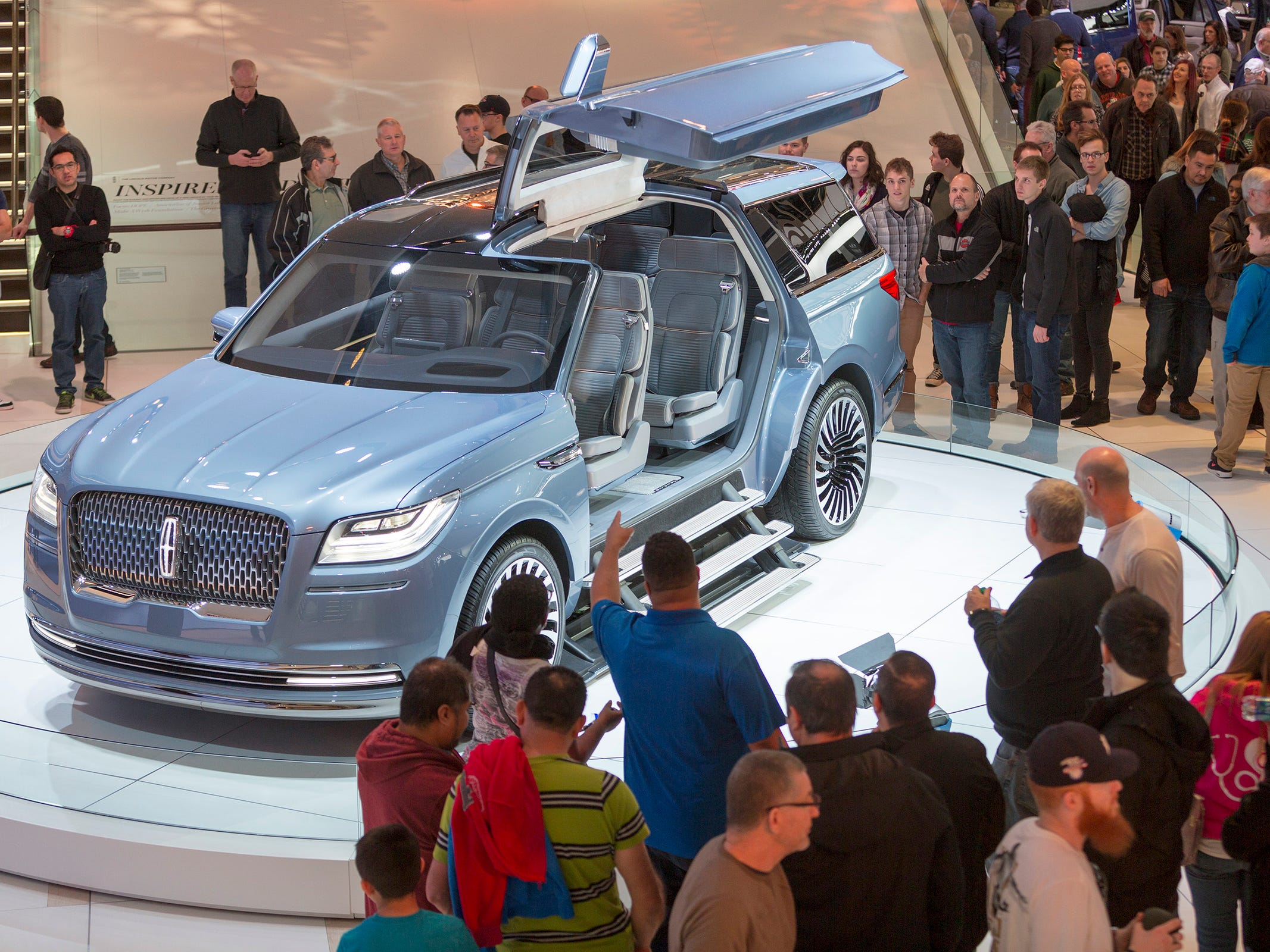 Attendees gather around the Lincoln Navigator Concept during the 2017 North American International Auto Show public day at Cobo Center in Detroit on Saturday, January 14, 2017.