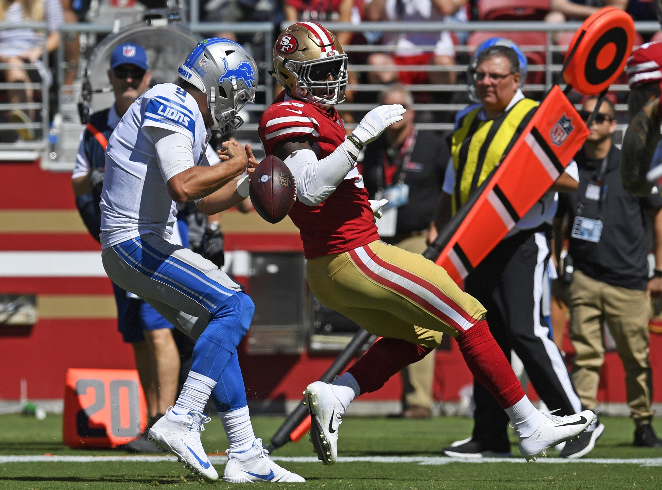 Lions quarterback Matthew Stafford fumbles the ball after being pressured by the 49ers' Elijah Lee in the second quarter of the Lions' 30-27 loss on Sunday, Sept. 16, 2018, in Santa Clara, Calif.