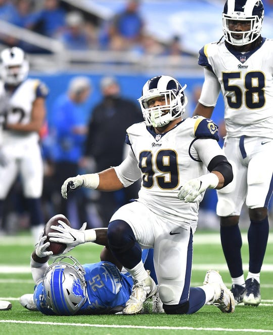 Rams defensive lineman Aaron Donald stops Lions running back Theo Riddick for a short gain Dec. 2, 2018, at Ford Field.