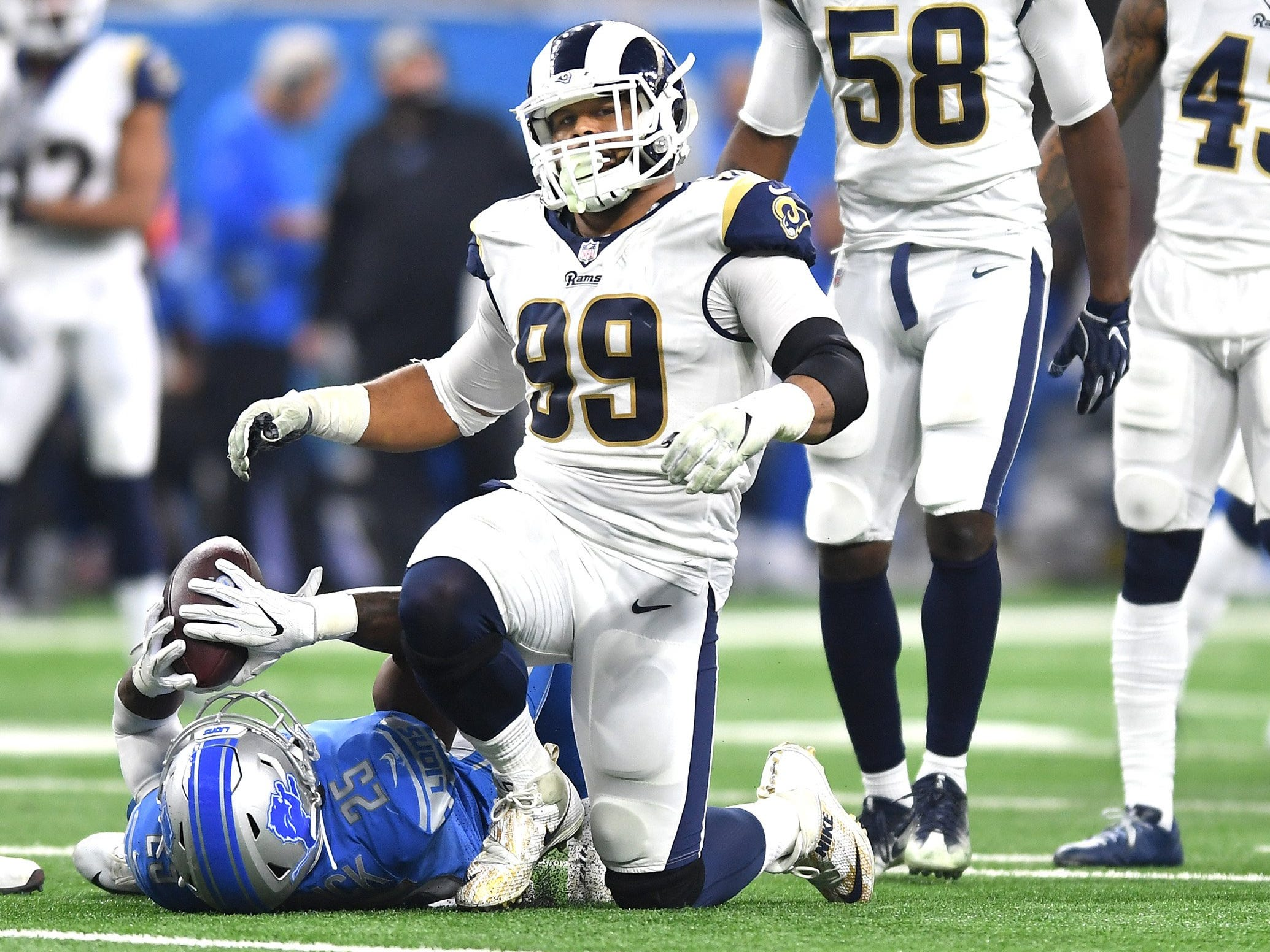 Rams defensive lineman Aaron Donald Lions running back Theo Riddick for a short gain in the first quarter of the Lions' 30-16 loss on Sunday, Dec. 2, 2018, at Ford Field.