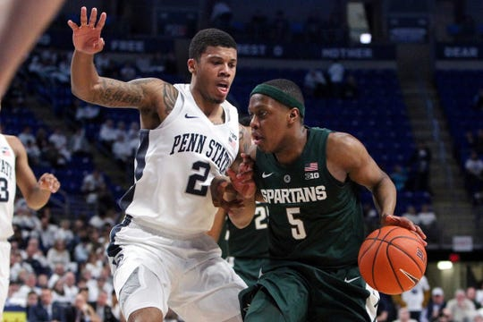 Michigan State guard Cassius Winston drives to the basket as Penn State guard Myles Dread defends in the second half in State College, Pa. Sunday, Jan. 13, 2019.