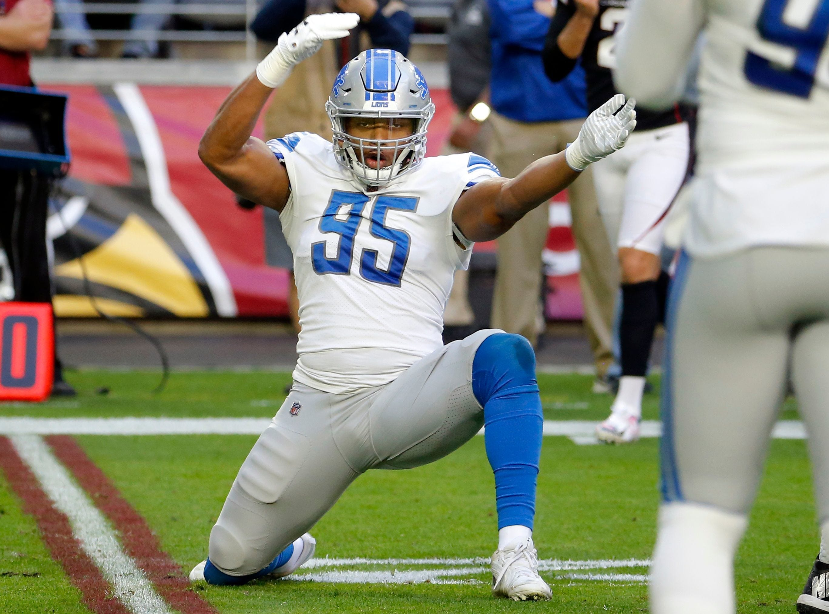 Lions defensive end Romeo Okwara celebrate his sack against the Cardinals during the first half of the Lions' 17-3 win on Sunday, Dec. 9, 2018, in Glendale, Ariz.