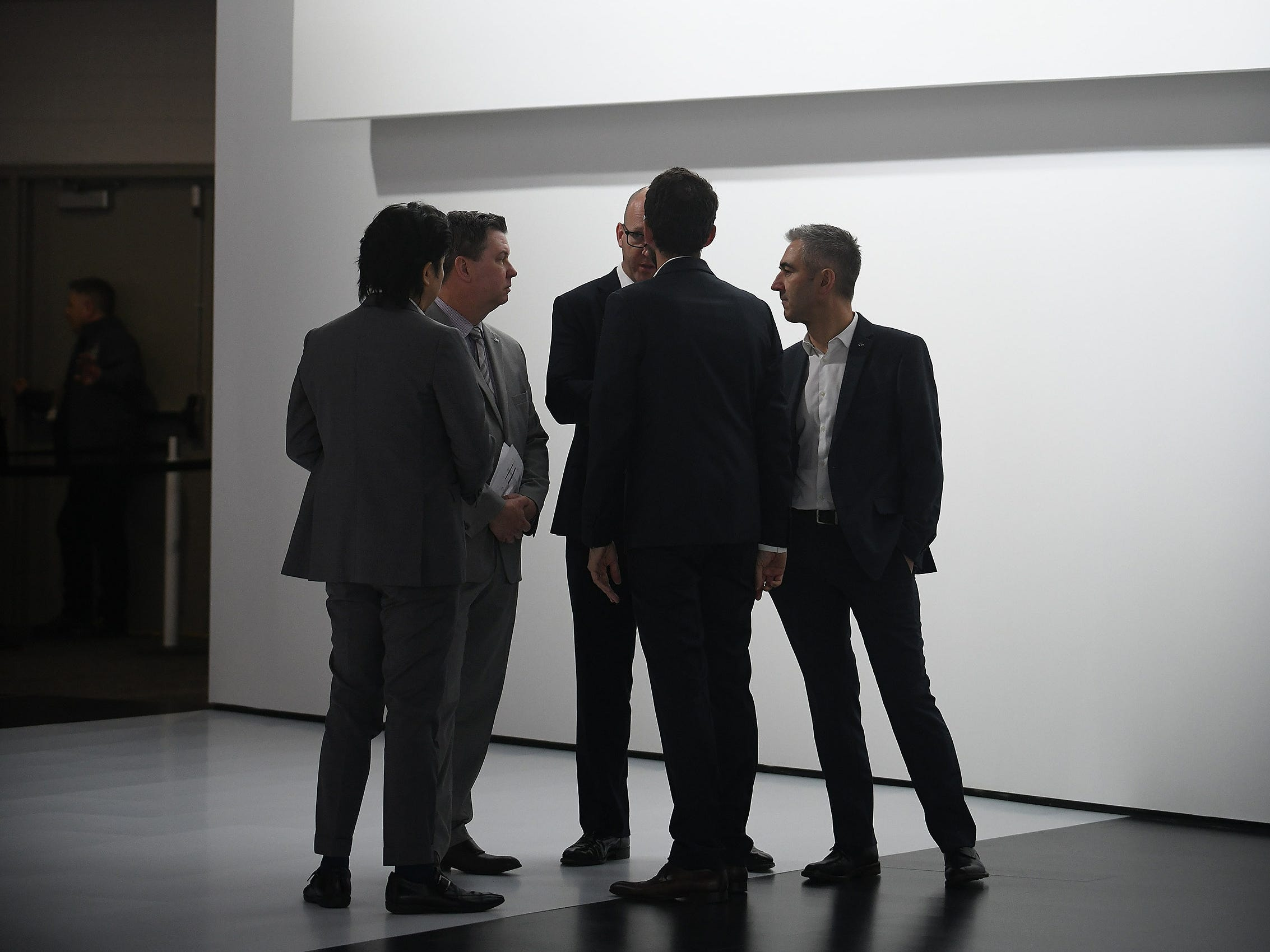 Executives from Infiniti gather and talk after the press event.