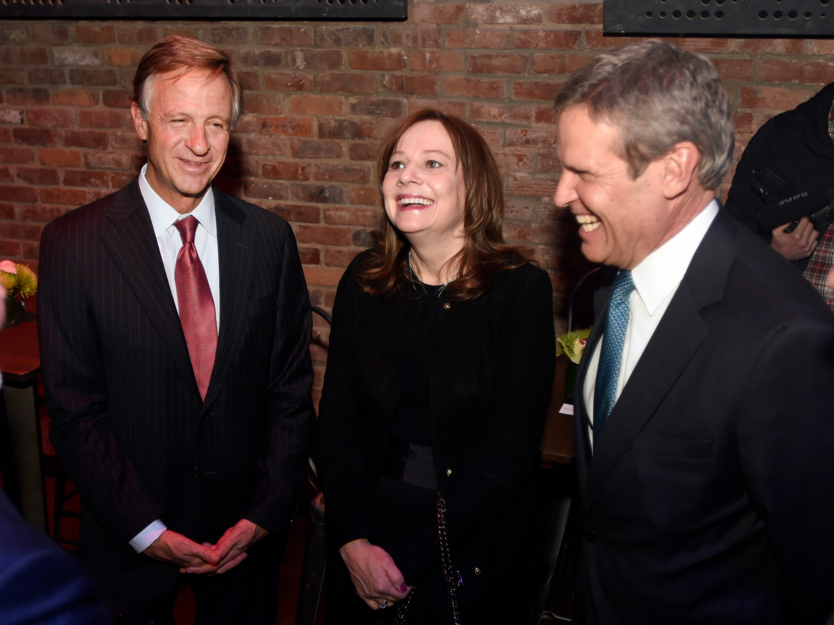 From left, Tennessee Gov. Bill Haslam, General Motors CEO Mary Barra and Tennessee Gov.-Elect Bill Lee share a laugh before the unveiling of the 2020 Cadillac XT6.
