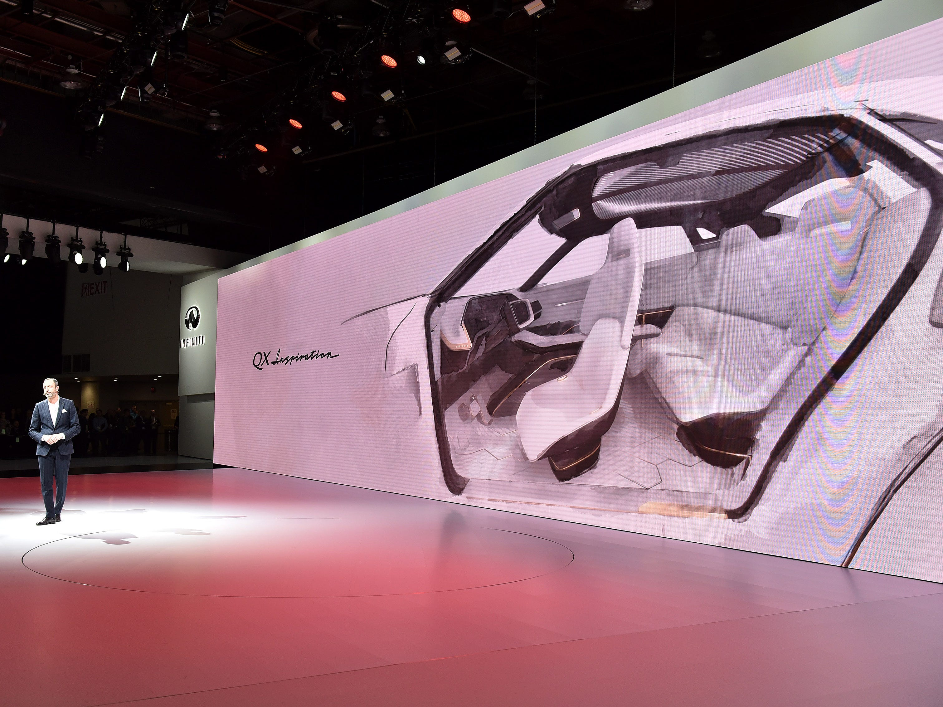 Karem Habib, executive design director, Infiniti Motor Company, talks about the Infiniti QX Inspiration concept vehicle, waiting for it to drive on stage, at their press event in Detroit, Monday. The QX Inspiration had technical issues and did not make it to the stage during the presser.