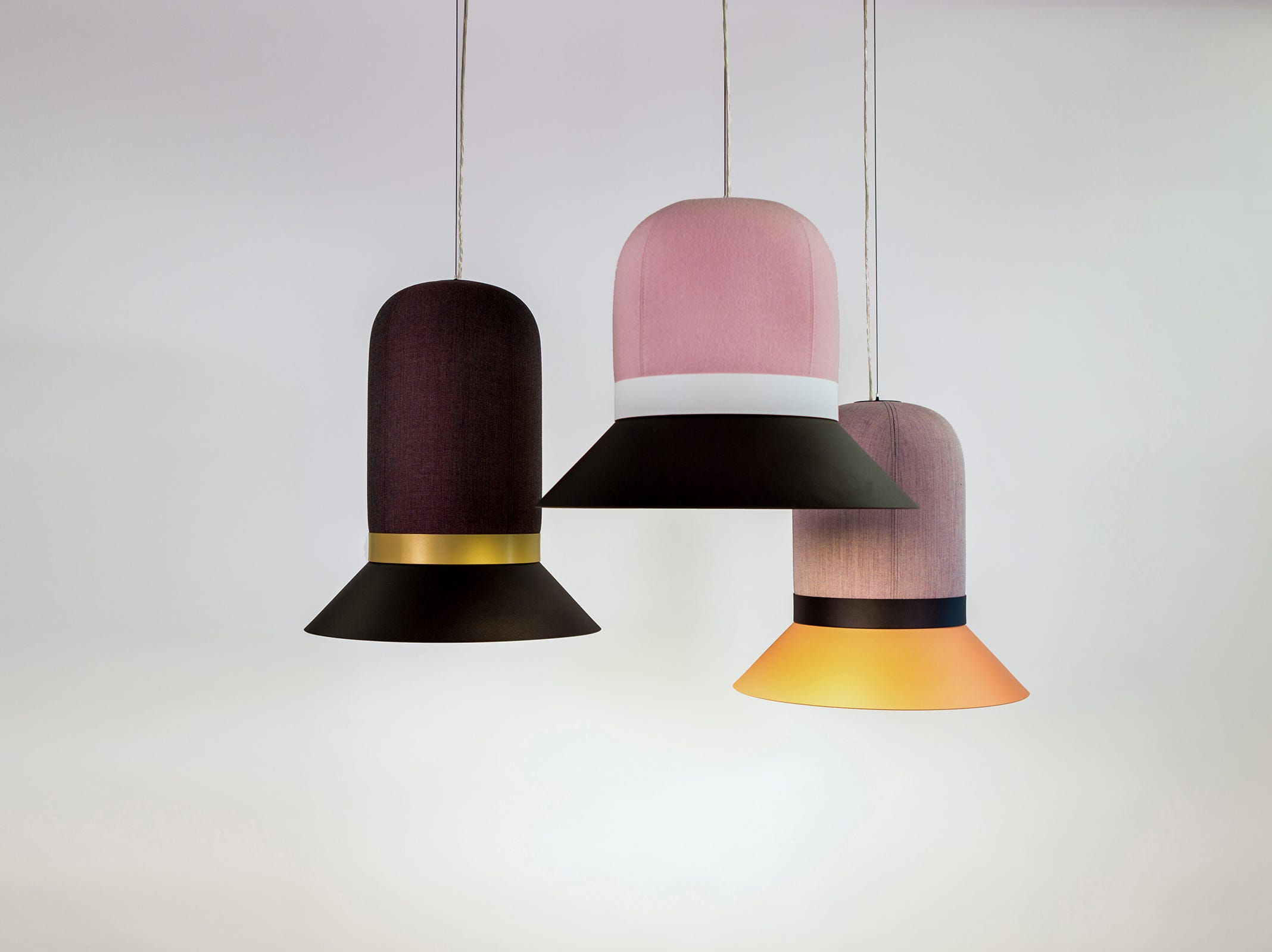 The form is undeniably a hat -- a rather old-fashioned one at that, but in a striking mix of modern hues. These fabric-over-foam light with metal pendants called BuzziHat also are sound absorbent. Ring is available in four finishes -- black, white, beige-red, and gold -- and pieces may be customized to match your own fabric.