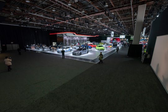 Large open areas are visible near the Kia Telluride exhibit on the main show floor of the North American International Auto Show at Cobo Center, an indication of the show's changing nature.