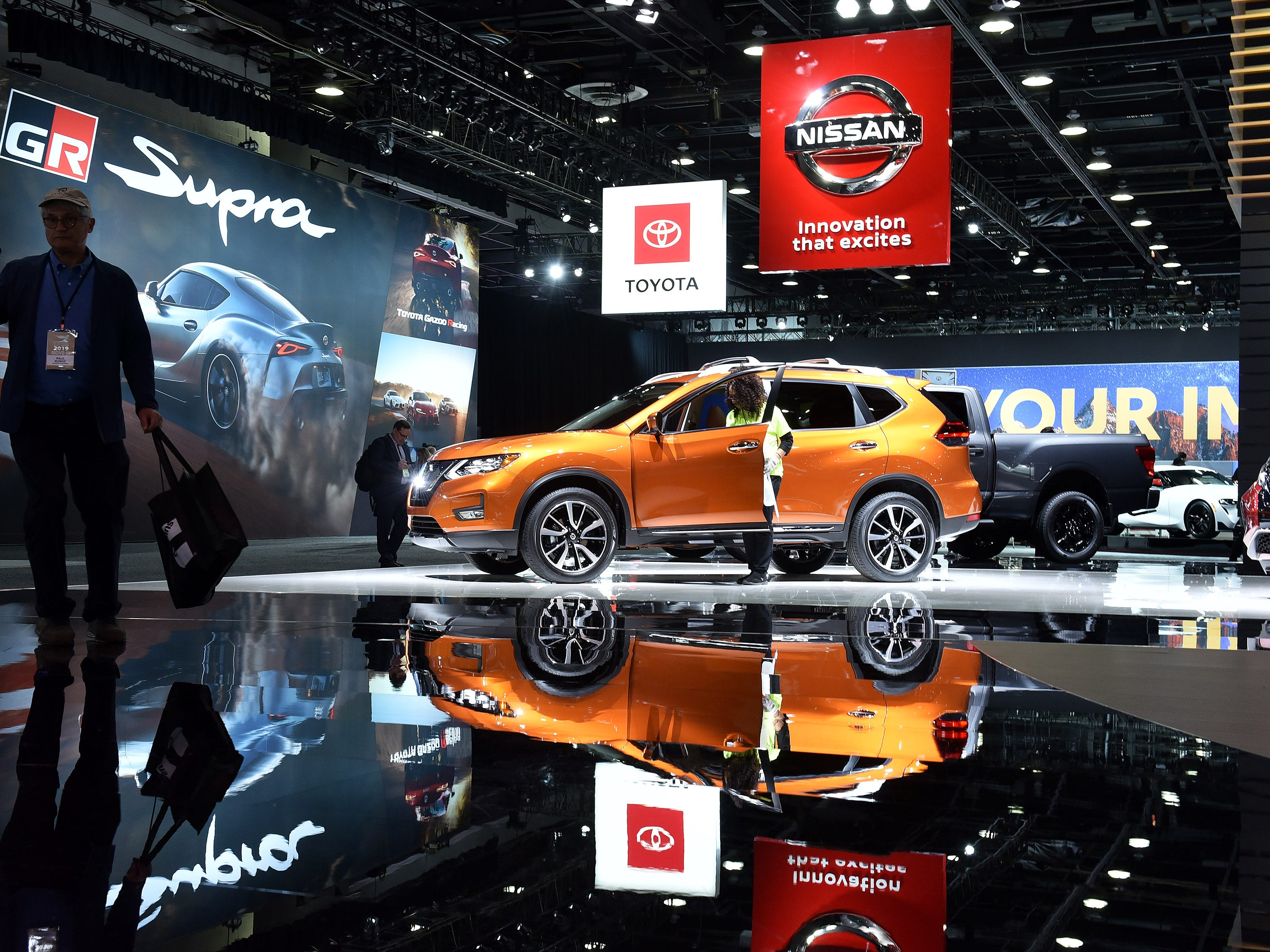 Intech Kelly Services employee Patricia Ursula Brown of Detroit cleans a Nissan Rogue at the North American International Auto Show at Cobo Center in Detroit on Jan. 14, 2019.