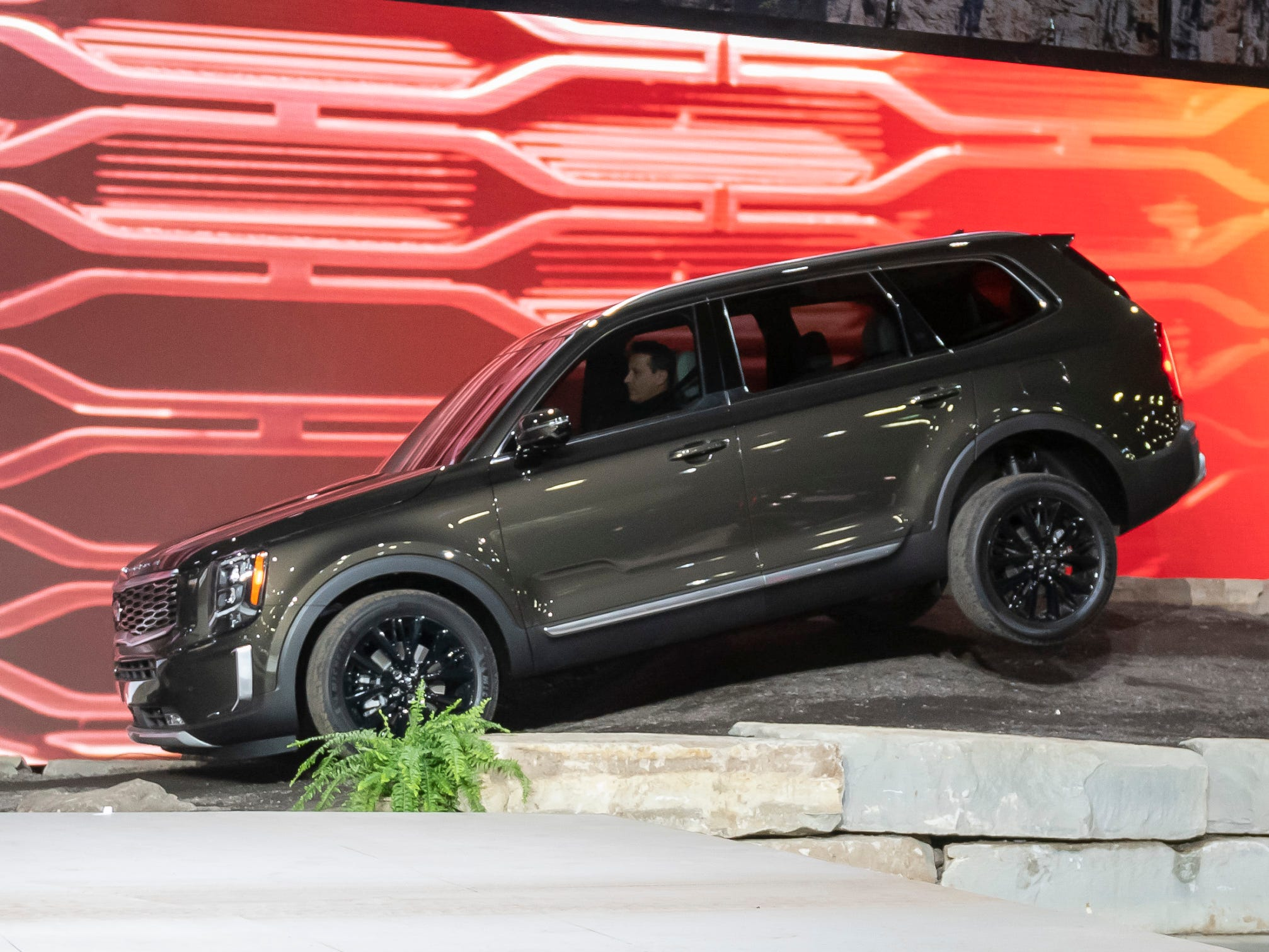 The 2020 Kia Telluride is driven on an off-road road course during its reveal at the North American International Auto Show at Cobo Center in Detroit, Jan. 14, 2019.