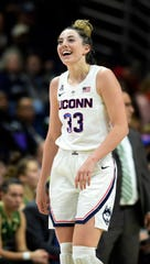 Connecticut's Katie Lou Samuelson (33) smiles shortly after surpassing her 2,000th college career point in the second half. No. 3 UConn defeated South Florida 63-46.