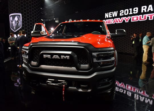 People check out the 2019 Ram Power Wagon after its introduction Monday.