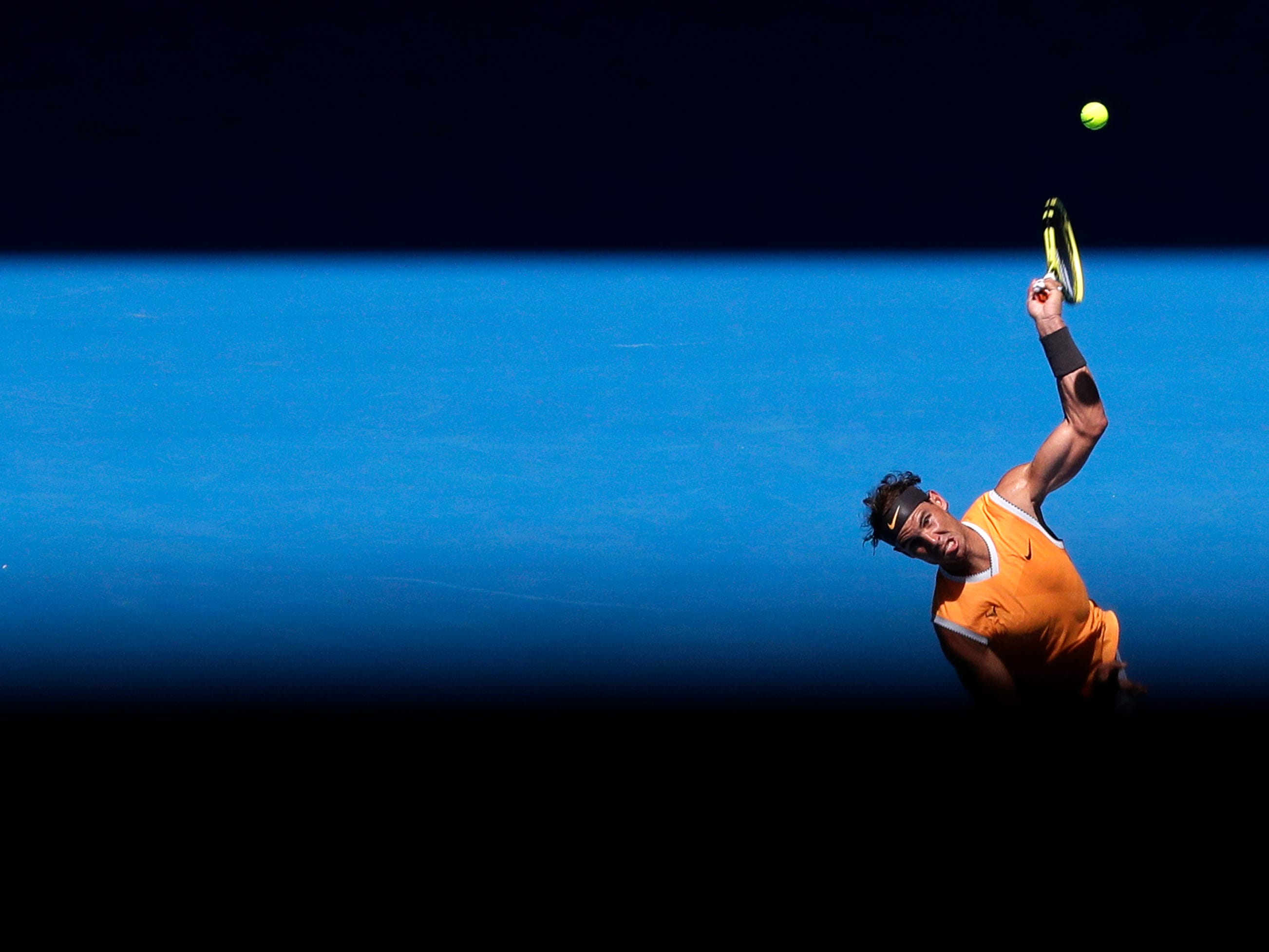 Spain's Rafael Nadal serves to Australia's James Duckworth in their first round match at the Australian Open tennis championships in Melbourne, Australia, Monday, Jan. 14, 2019.