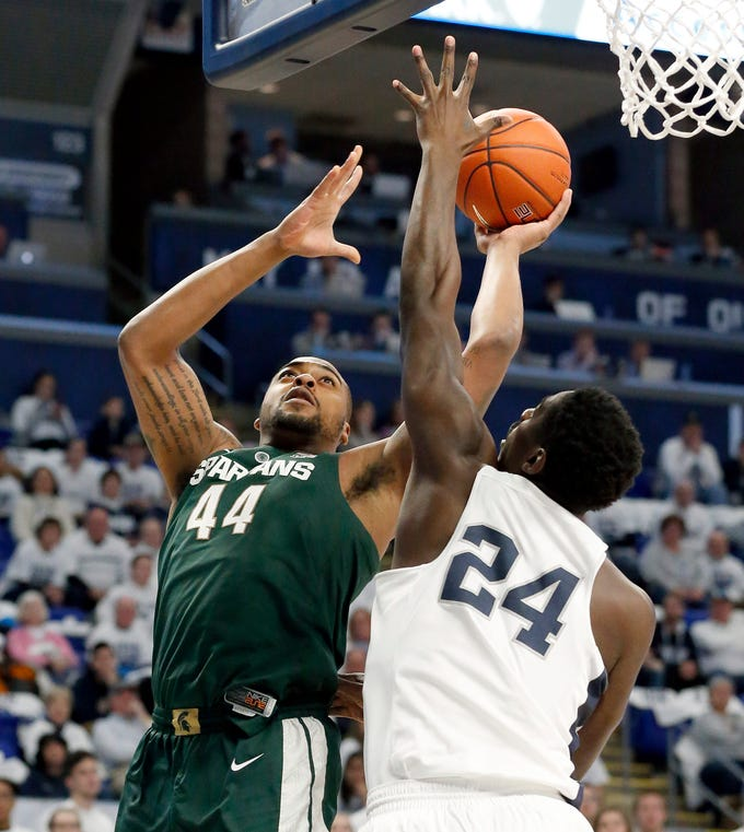 Michigan State's Nick Ward (44) shoots over Penn State's Mike Watkins (24) during the first-half of their game in State College, Pa. Sunday, Jan. 13, 2019. MSU wins, 71 to 56.