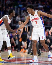 Reggie Jackson, left, Stanley Johnson and the Pistons wrap up the first half of the season with an 18-23 record.