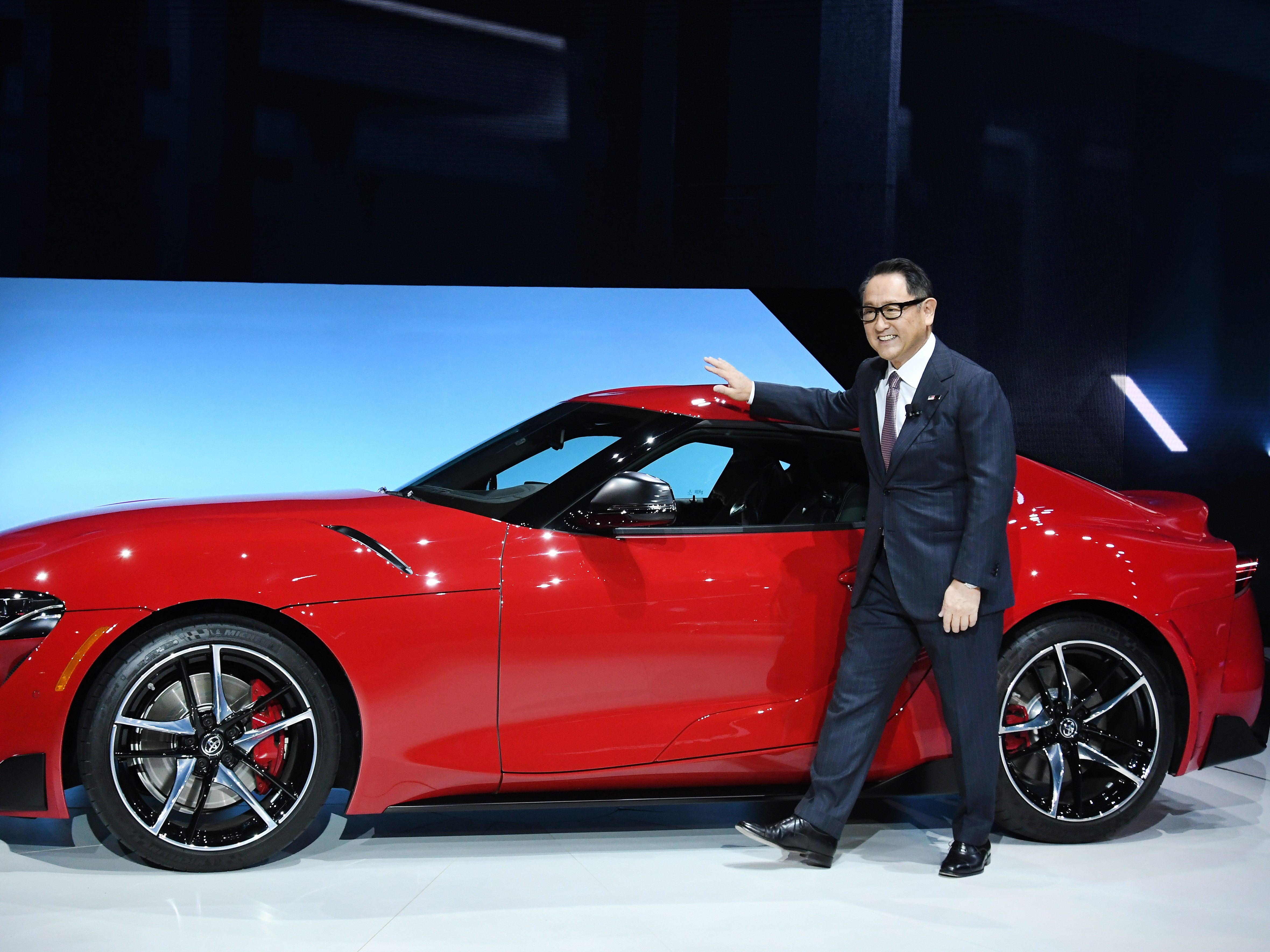 Toyota's President Akio Toyoda shows off the 2020 Toyota Supra at the North American International Auto Show in Detroit.