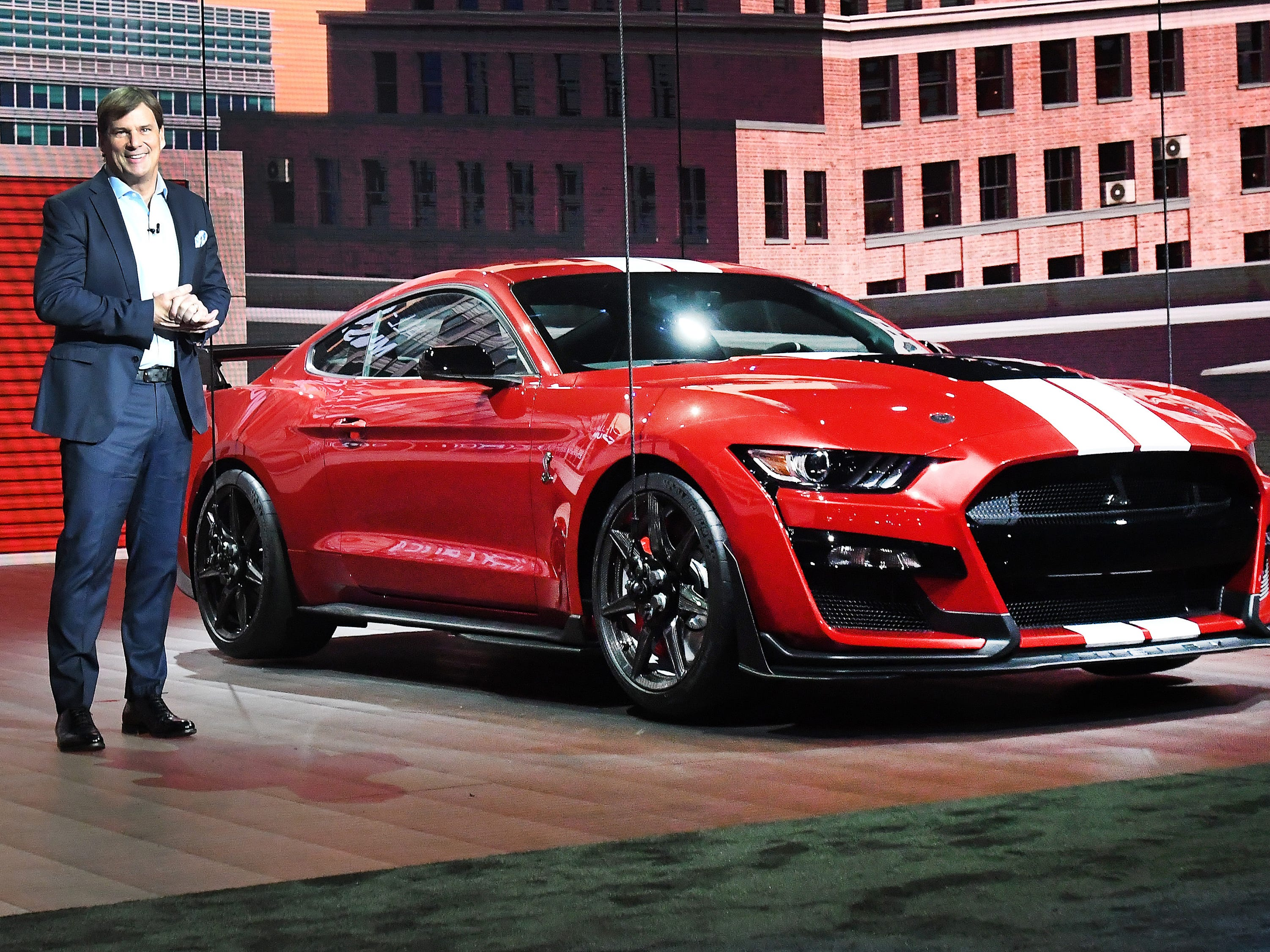 Ford executive Jim Farley introduces the Mustang GT500 at the Detroit auto show.