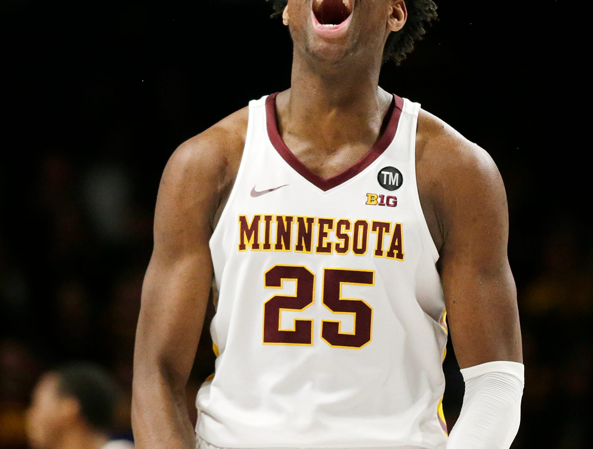 Minnesota center Daniel Oturu celebrates during the second half of an NCAA college basketball game against Rutgers Saturday, Jan. 12, 2019, in Minneapolis. Minnesota defeated Rutgers 88-70. (AP Photo/Andy Clayton-King)