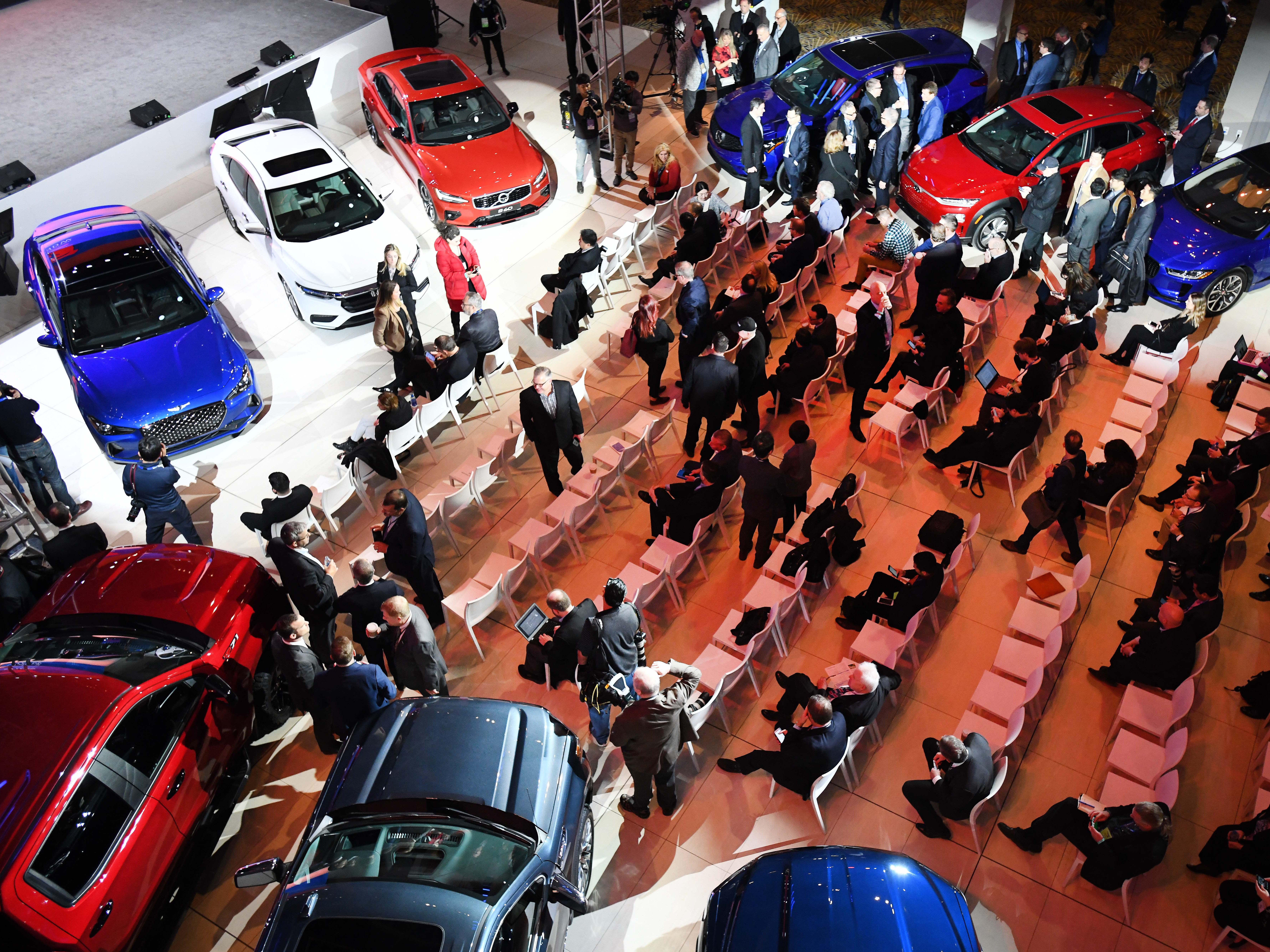 Media members arrive for the Car of the Year presentation at the North American International Auto Show .