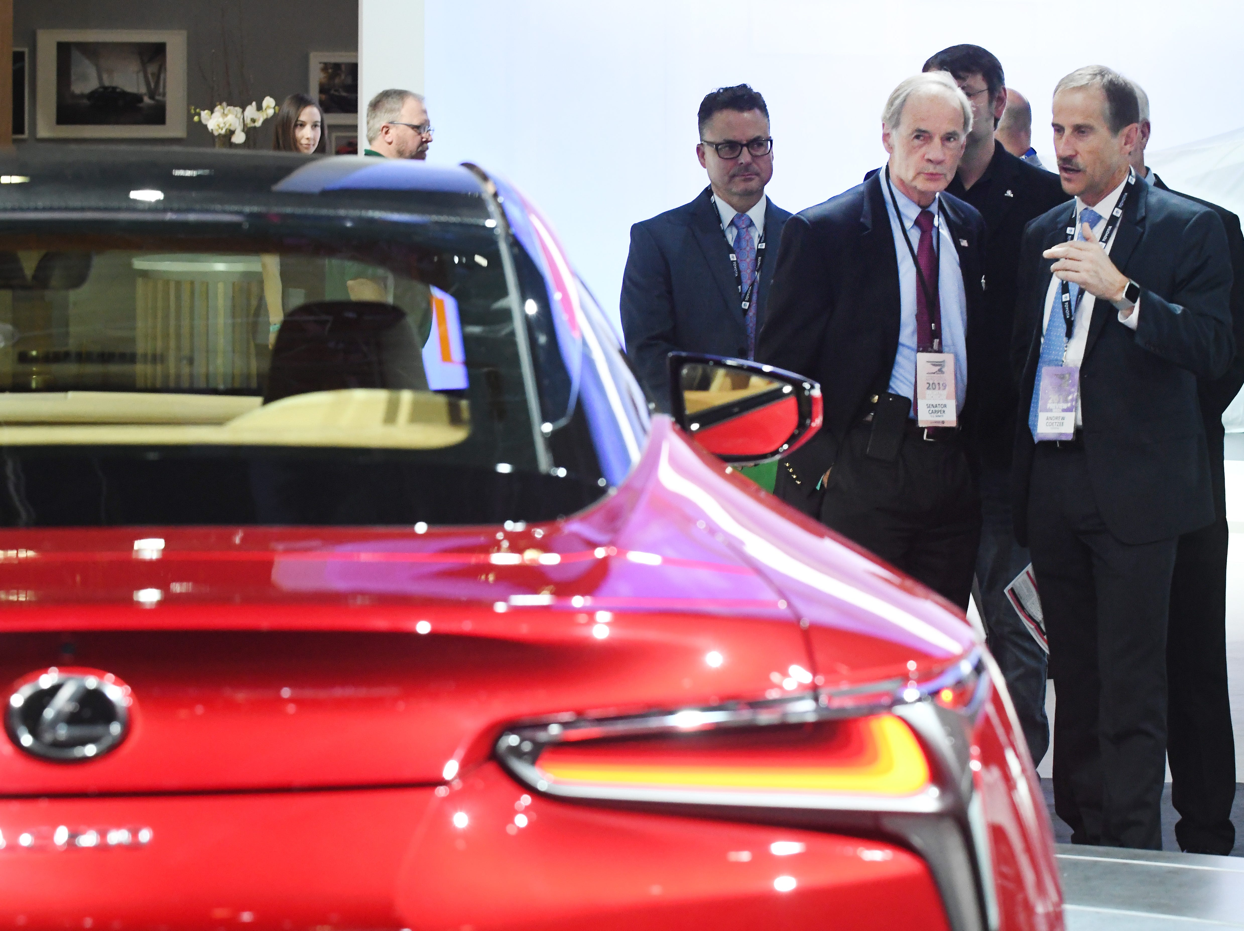 U.S. Sen. Tom Carper of Delaware gets a tour of the Lexus display from Andrew Coetzee of Toyota.