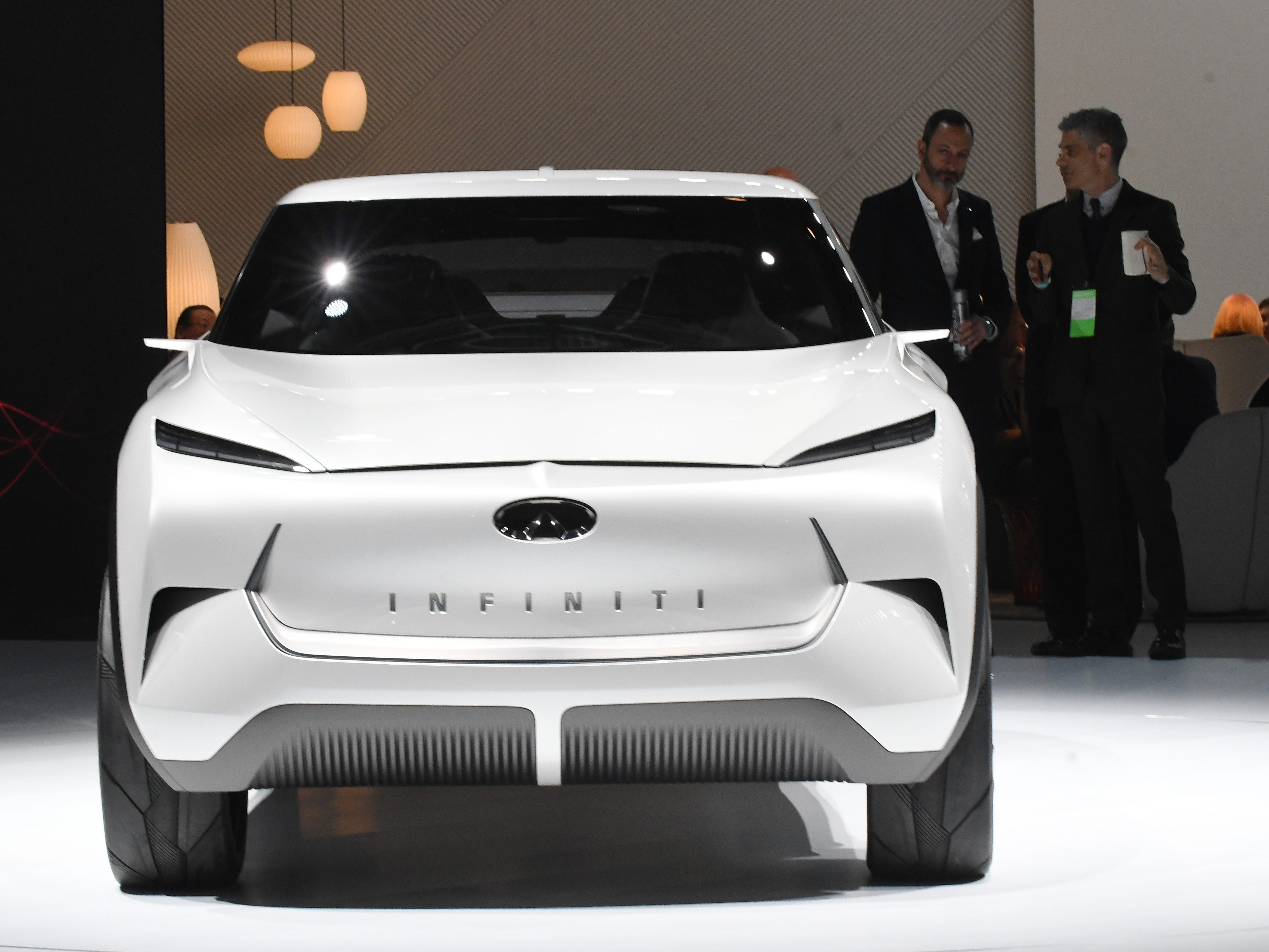 The Infiniti QX Inspiration concept vehicle is finally on display in Detroit after being pushed onto the stage and uncovered.