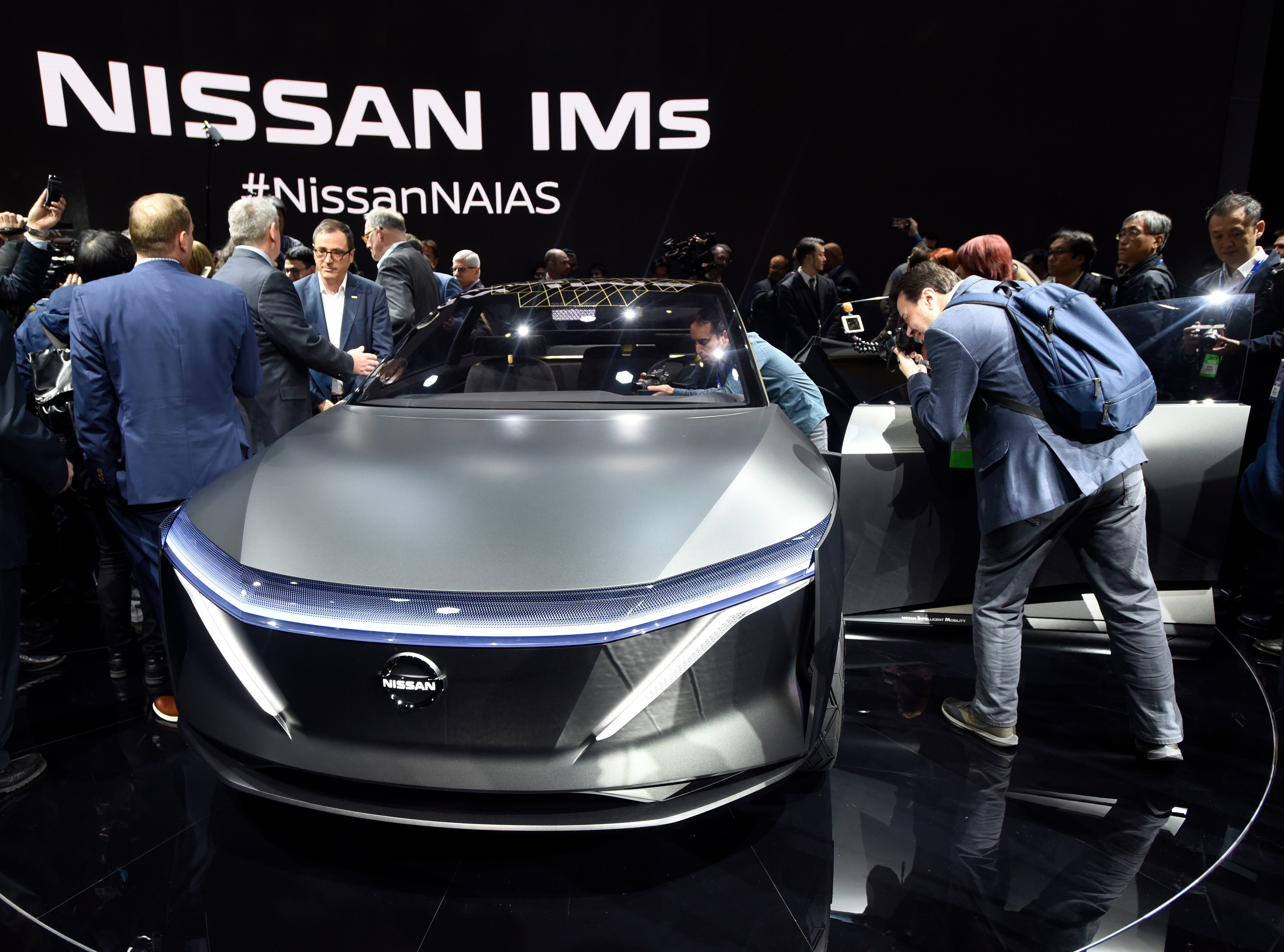 Media members take photos of the just- unveiled Nissan IMs.Juarez/Special to Detroit News)