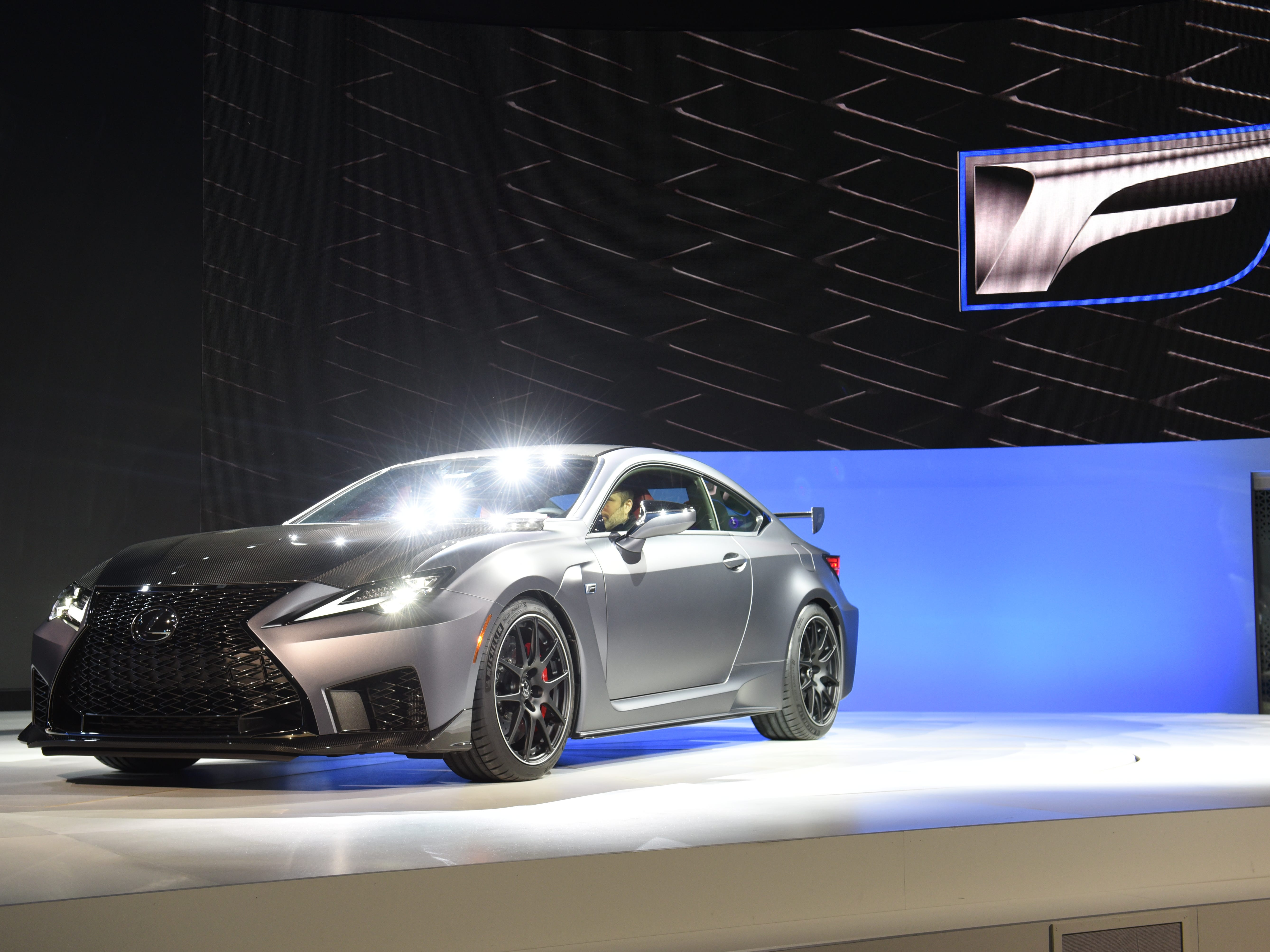 Journalists view The Lexus RC F Track Edition.