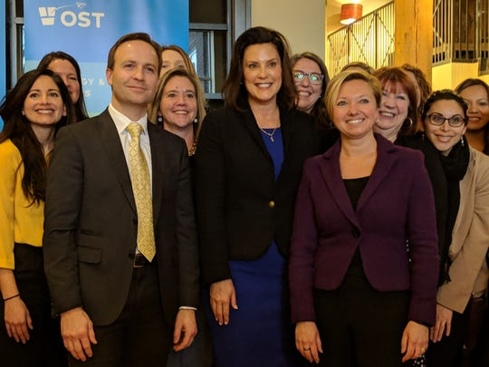 Gov. Gretchen Whitmer, former Lt. Gov. Brian Calley, Grand Rapids Mayor Rosalynn Bliss and businesswoman gather at the OST technology firm.
