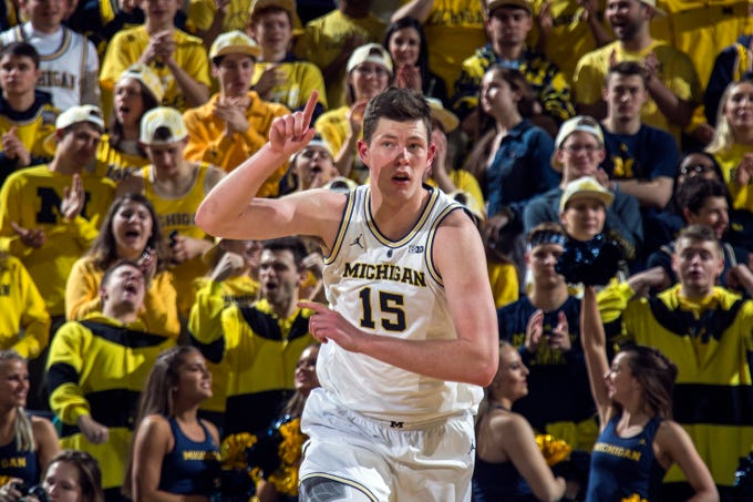 Michigan center Jon Teske (15) reacts after making a basket in the first half of an NCAA college basketball game against Northwestern at Crisler Center in Ann Arbor, Mich., Sunday, Jan. 13, 2019.