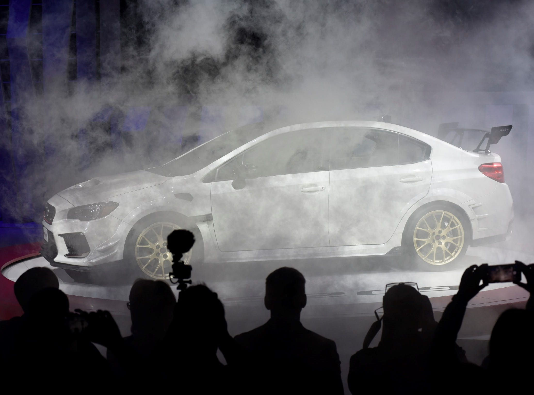 The Subaru S209 is unveiled on stage at the North American International Auto Show Monday, Jan. 14, 2019, in Detroit. The car is now available for the first time in America.