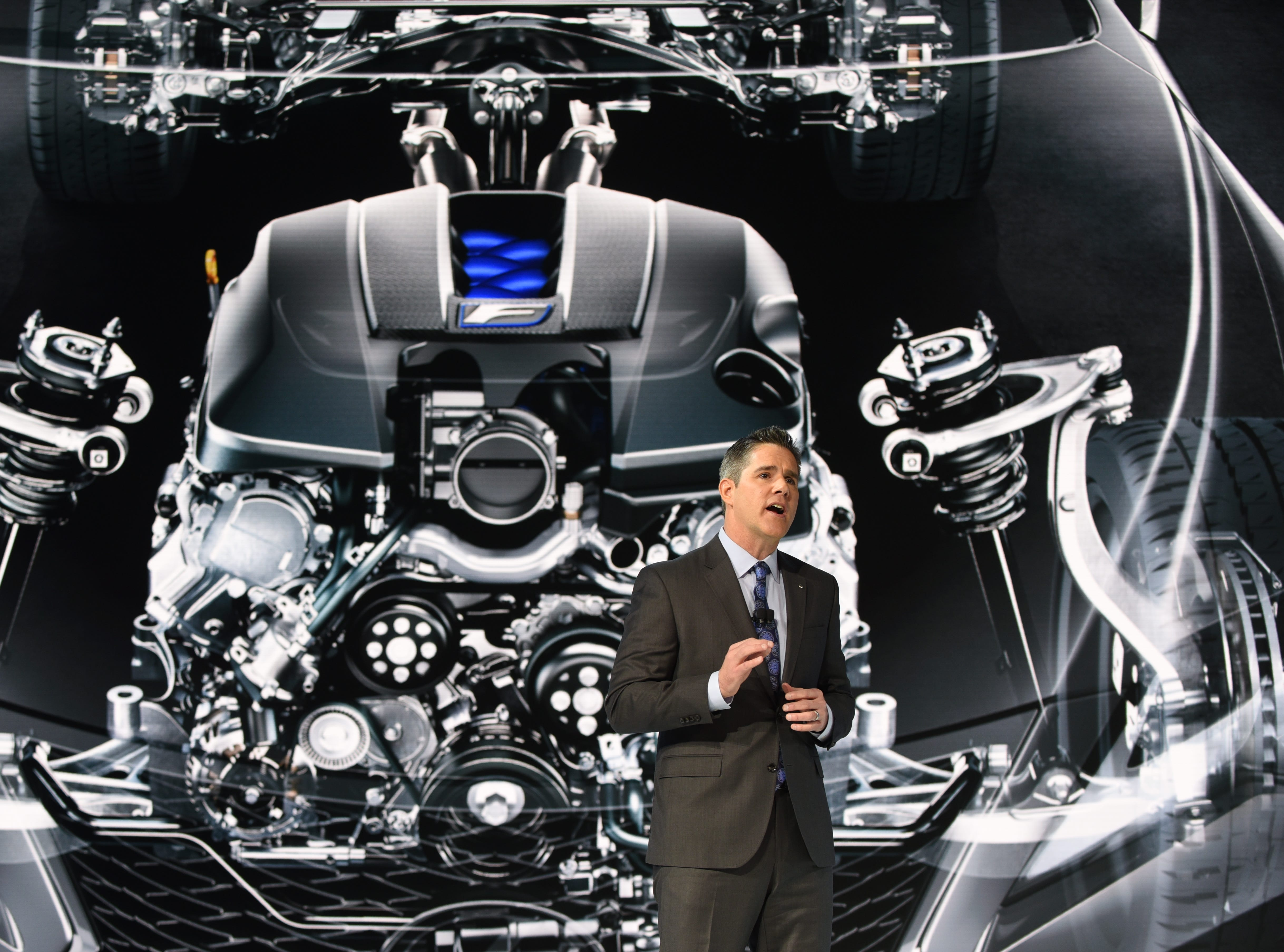 David Christ, group president and general manager, Lexus Division, speaks in front of a video display of the engine of the Lexus RC F Track Edition.