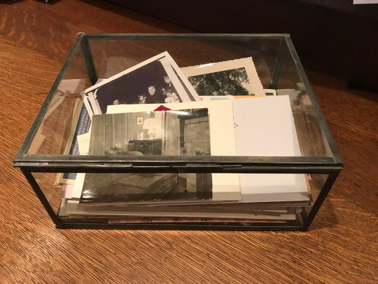 Metal and glass boxes can help to organize your personal items.