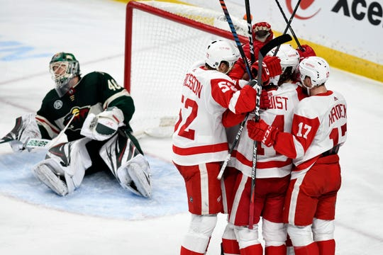 The Red Wings mob teammate Tyler Bertuzzi after he scored his third goal of the game Saturday against the Minnesota Wild.