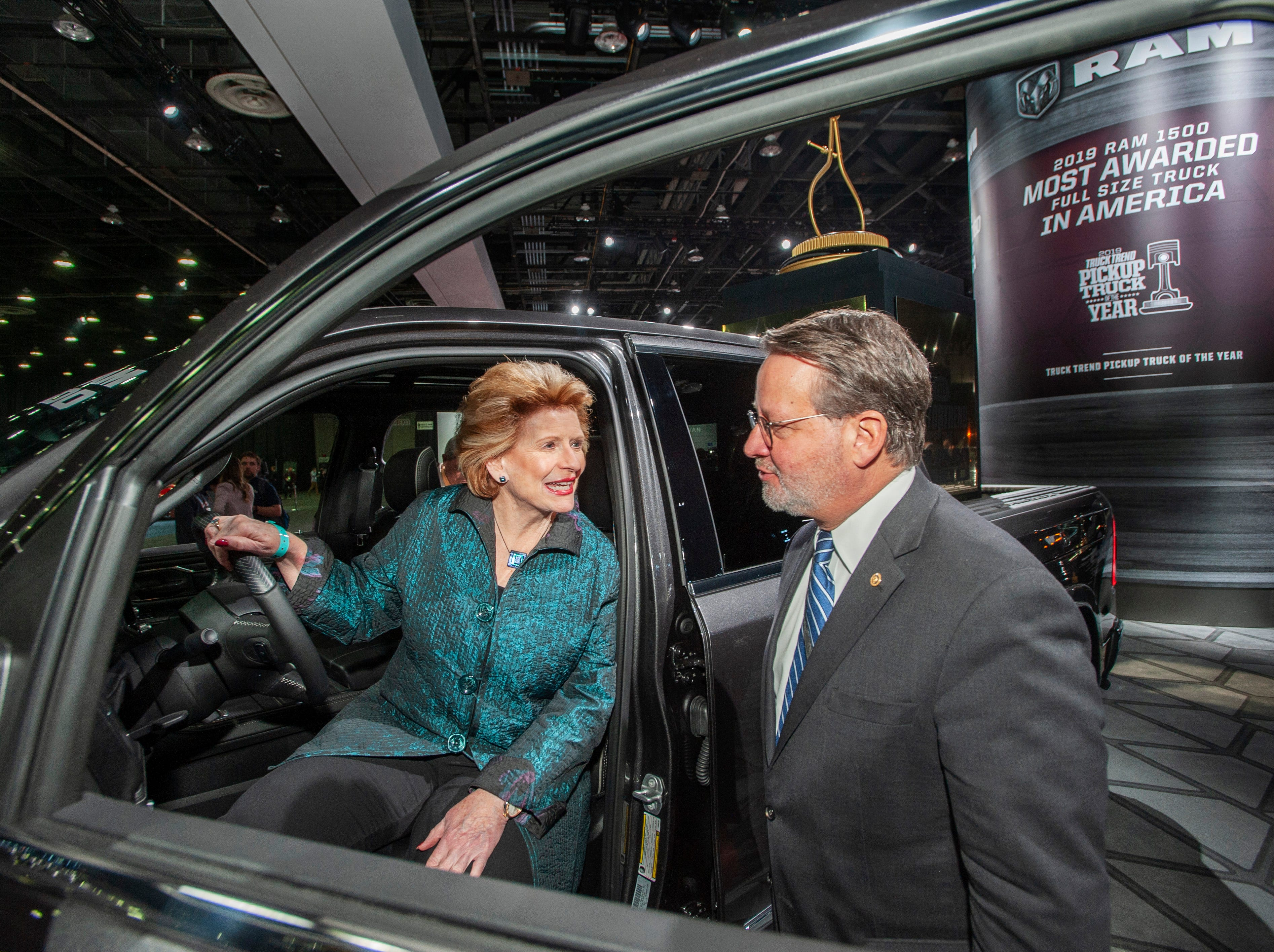 U.S. Sens. Debbie Stabenow and Gary Peters check out the Motor Trend 2019 Truck of the Year, the Ram 1500 Limited, while touring the show floor at the North American International Auto Show in Detroit on Monday, Jan. 14, 2019.
