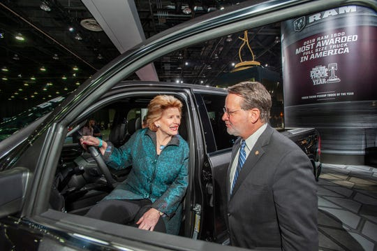 U.S. Sens. Debbie Stabenow and Gary Peters check out the Motor Trend 2019 Truck of the Year, the Ram 1500 Limited, while touring the show floor at the North American International Auto Show in Detroit on Monday