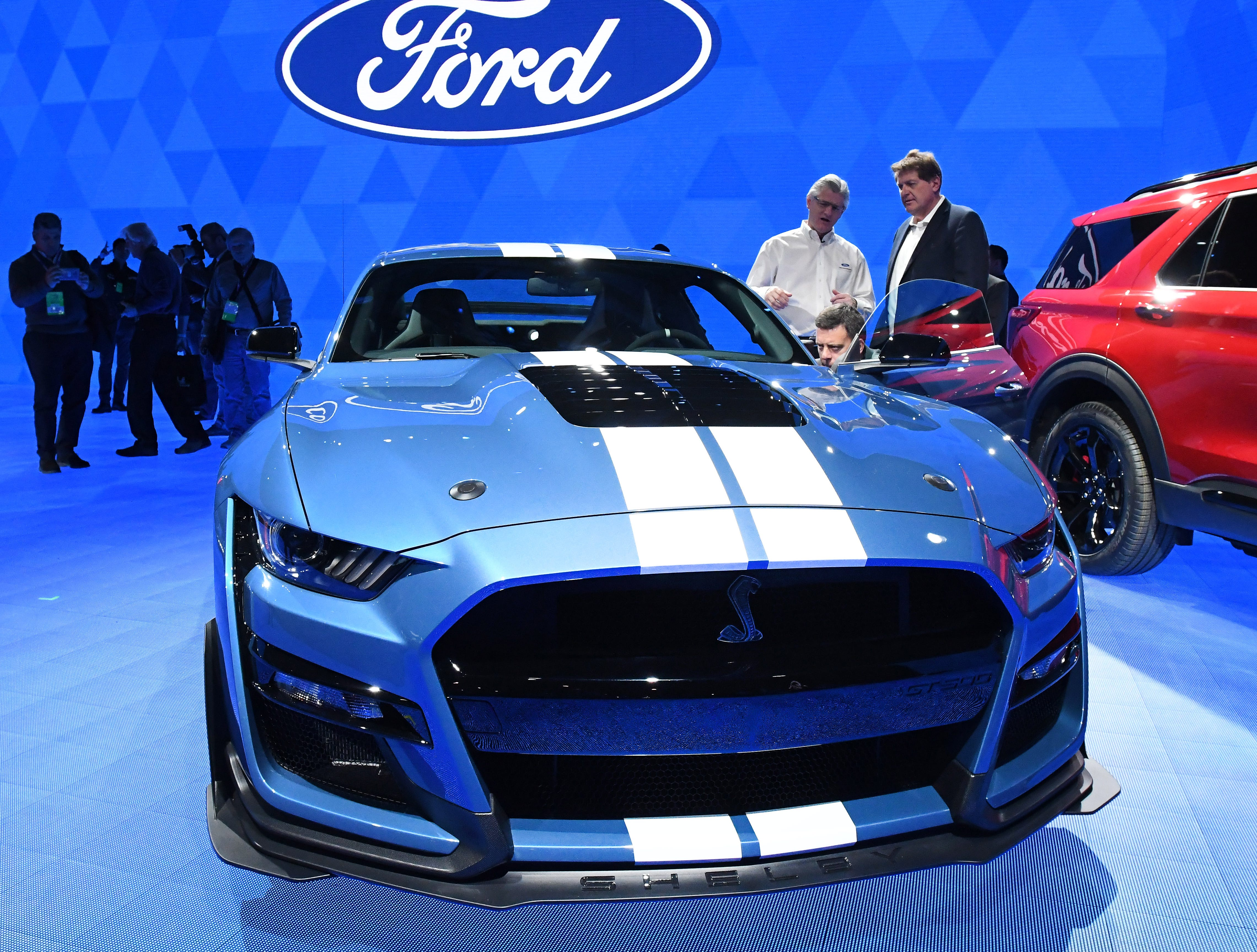 Members of the media look over the Mustang Shelby GT500 at the North American International Auto Show media preview day at Cobo Center in Detroit on Monday, Jan. 14, 2019.