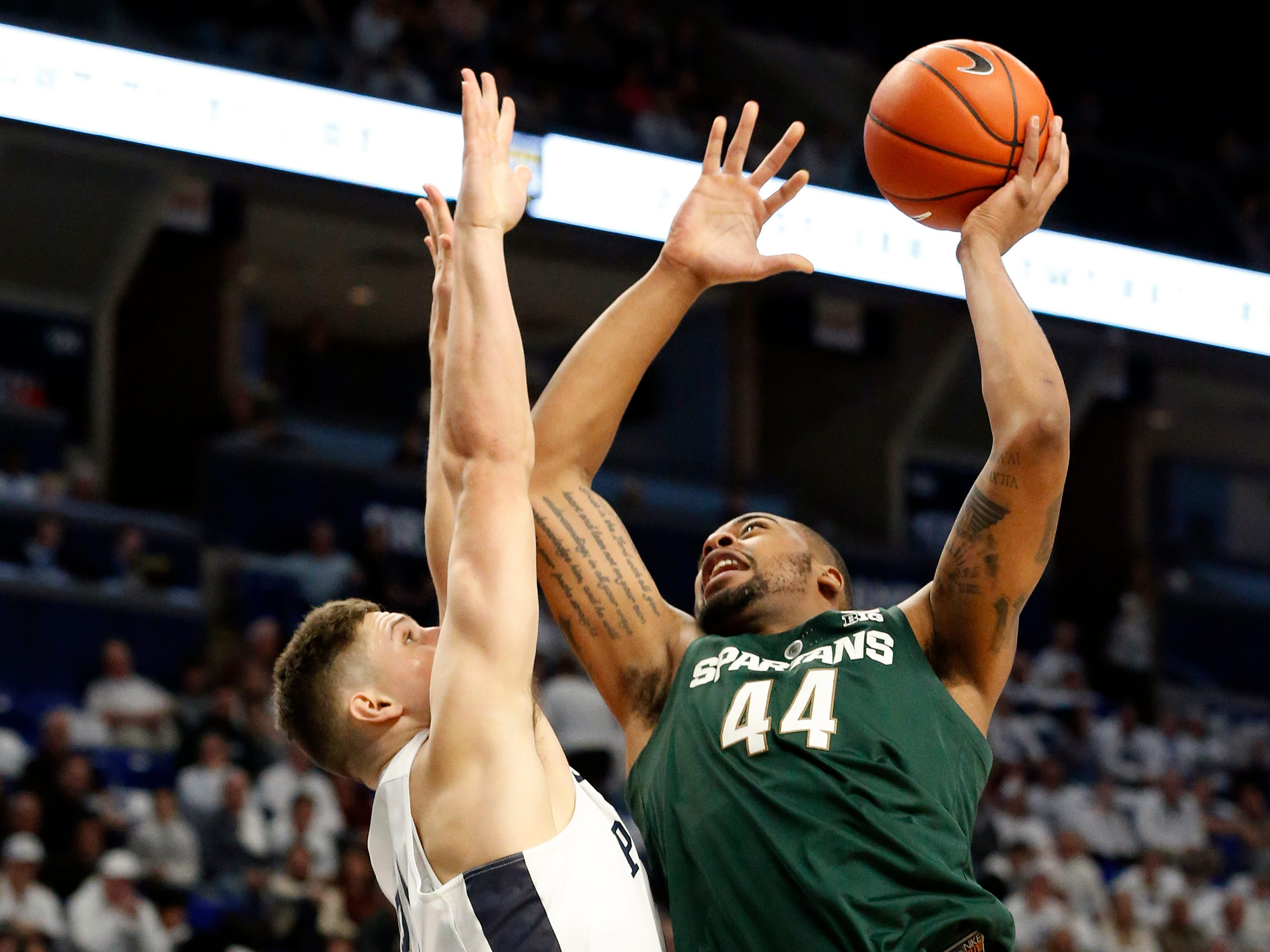 Michigan State's Nick Ward (44) shoots against Penn State's John Harrar (21) during first-half action.